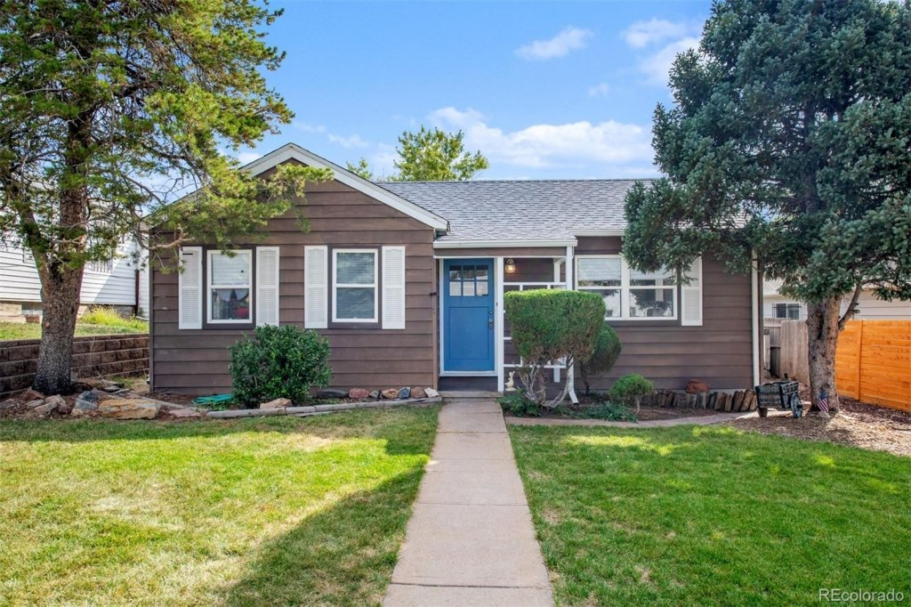 Starter home for sale, Barnum neighborhood, brown ranch style with blue front door