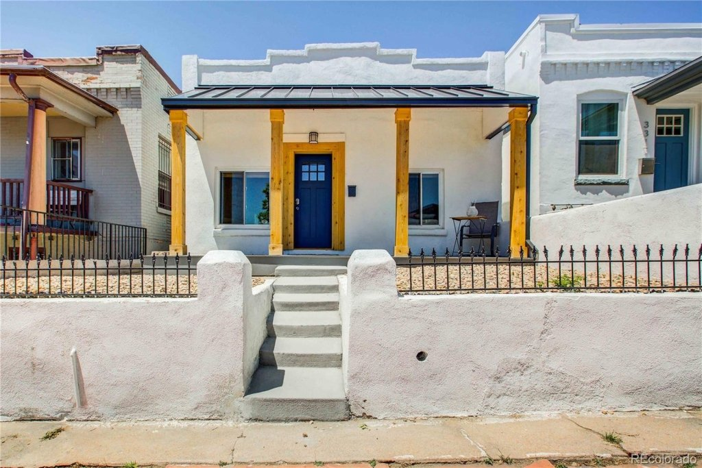 Starter home for sale, LoHi Neighborhood, white stucco with small porch