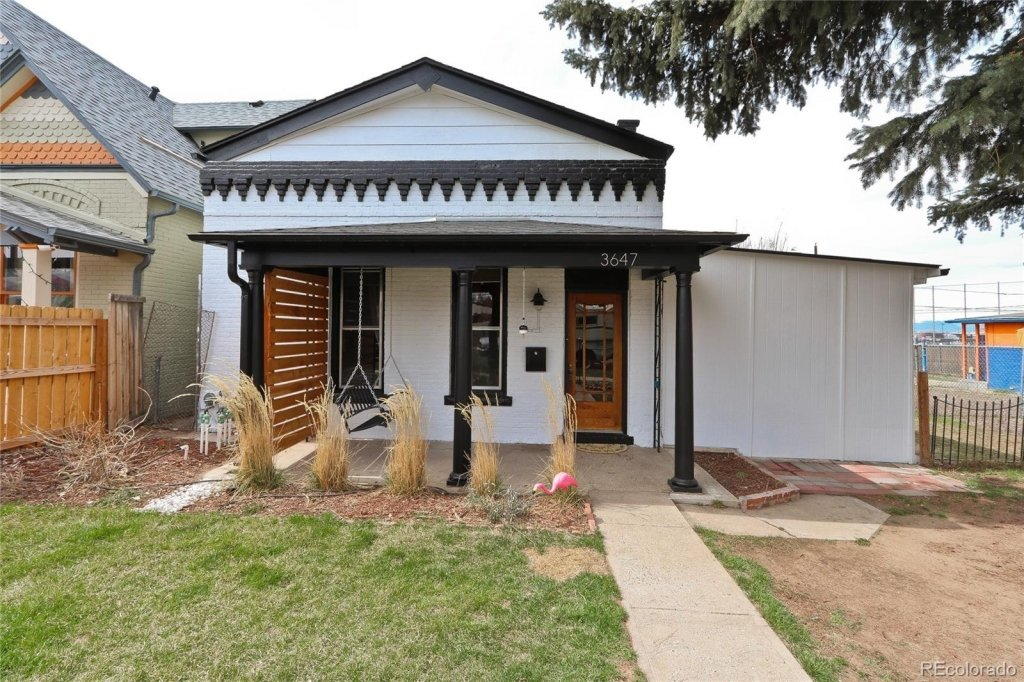Starter home for sale, North Park Hill Neighborhood, white brick with wood front door