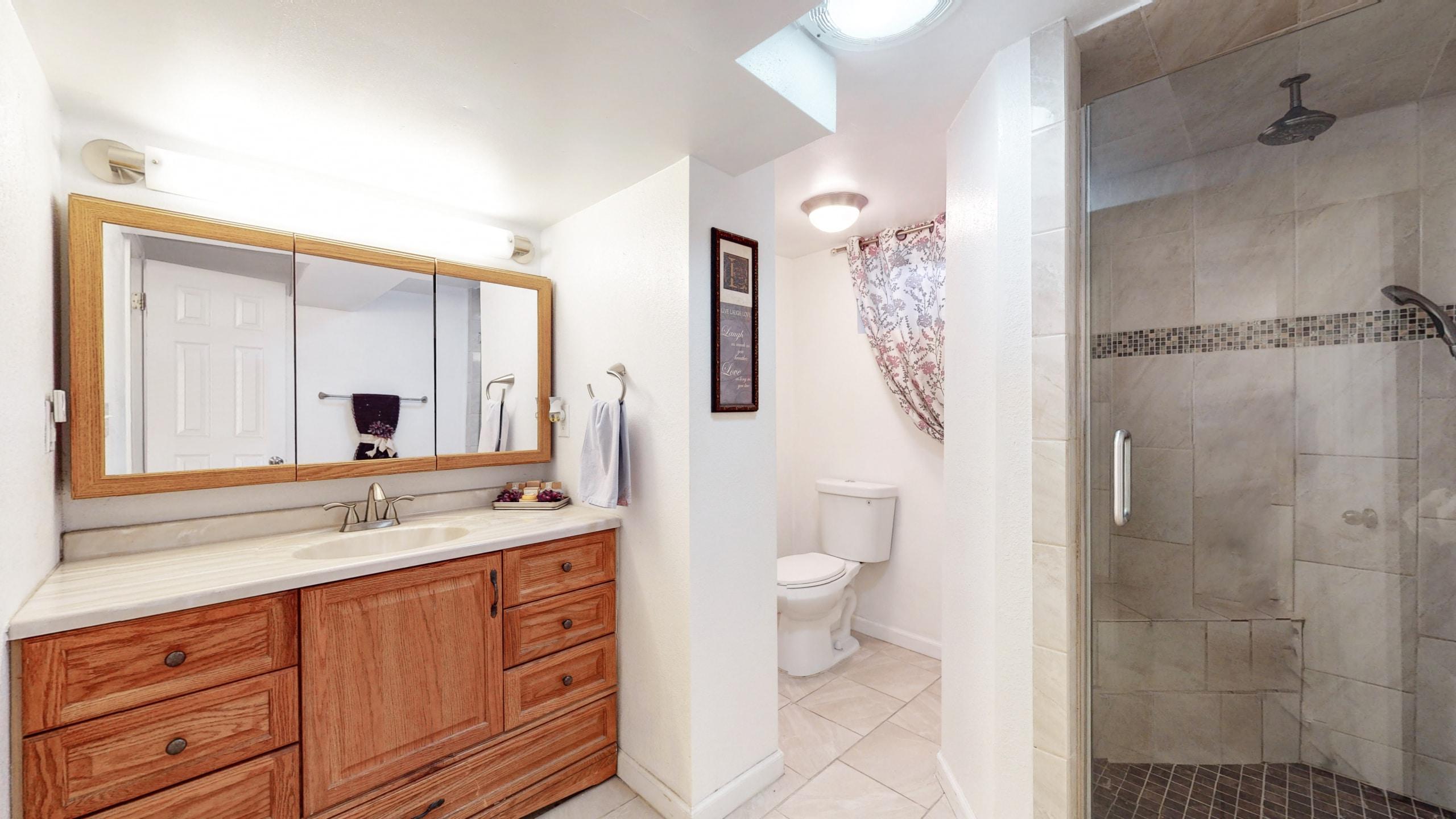 Arvada Home For Sale, Basement Bathroom, Beige tile shower, white tile floor