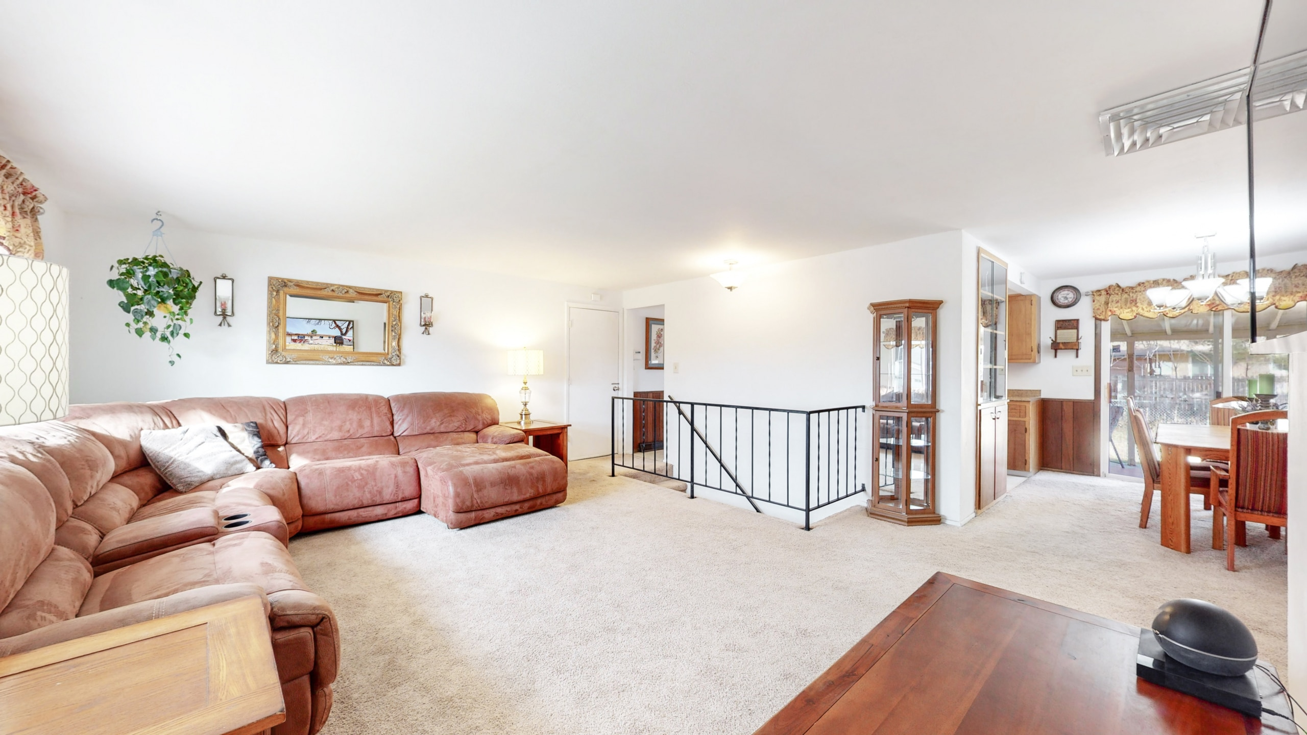 Arvada Home For Sale Large Living Room White Walls Brown Carpet