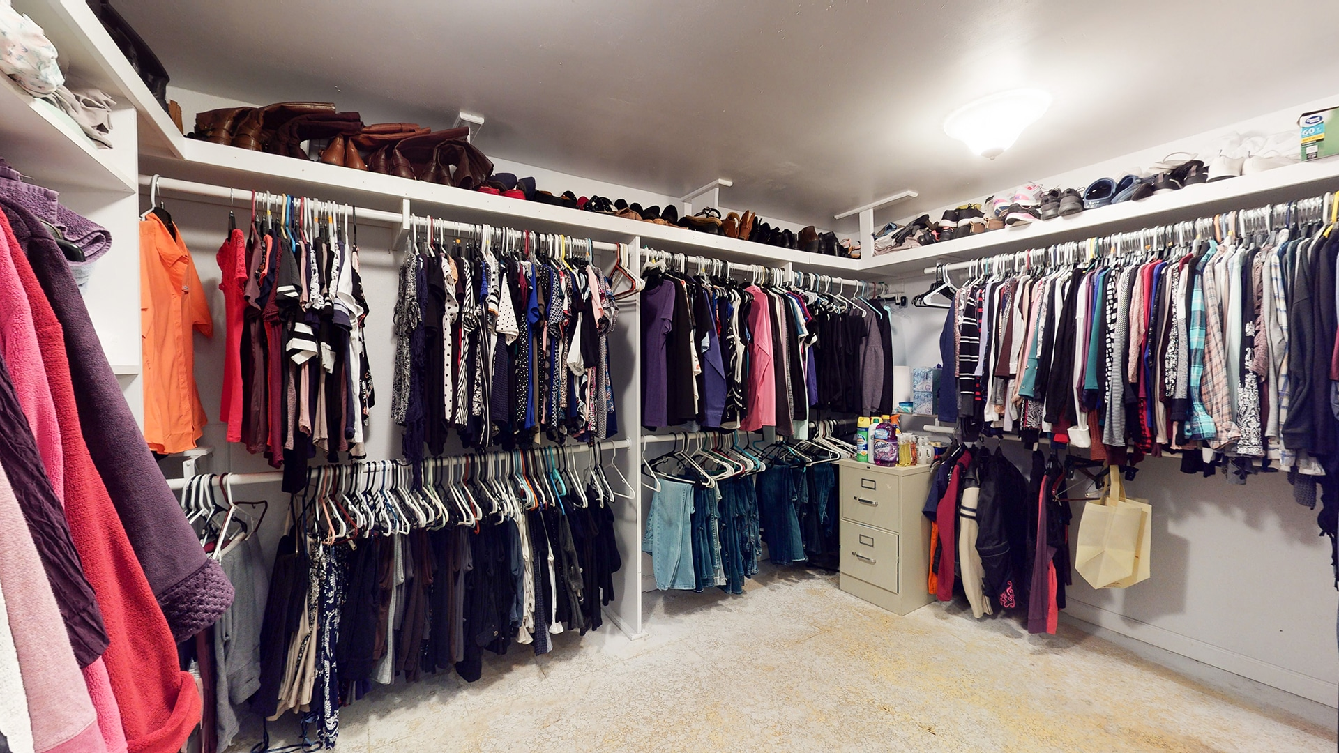 Arvada Home For Sale, Large Master Closet, Several Racks of Clothes