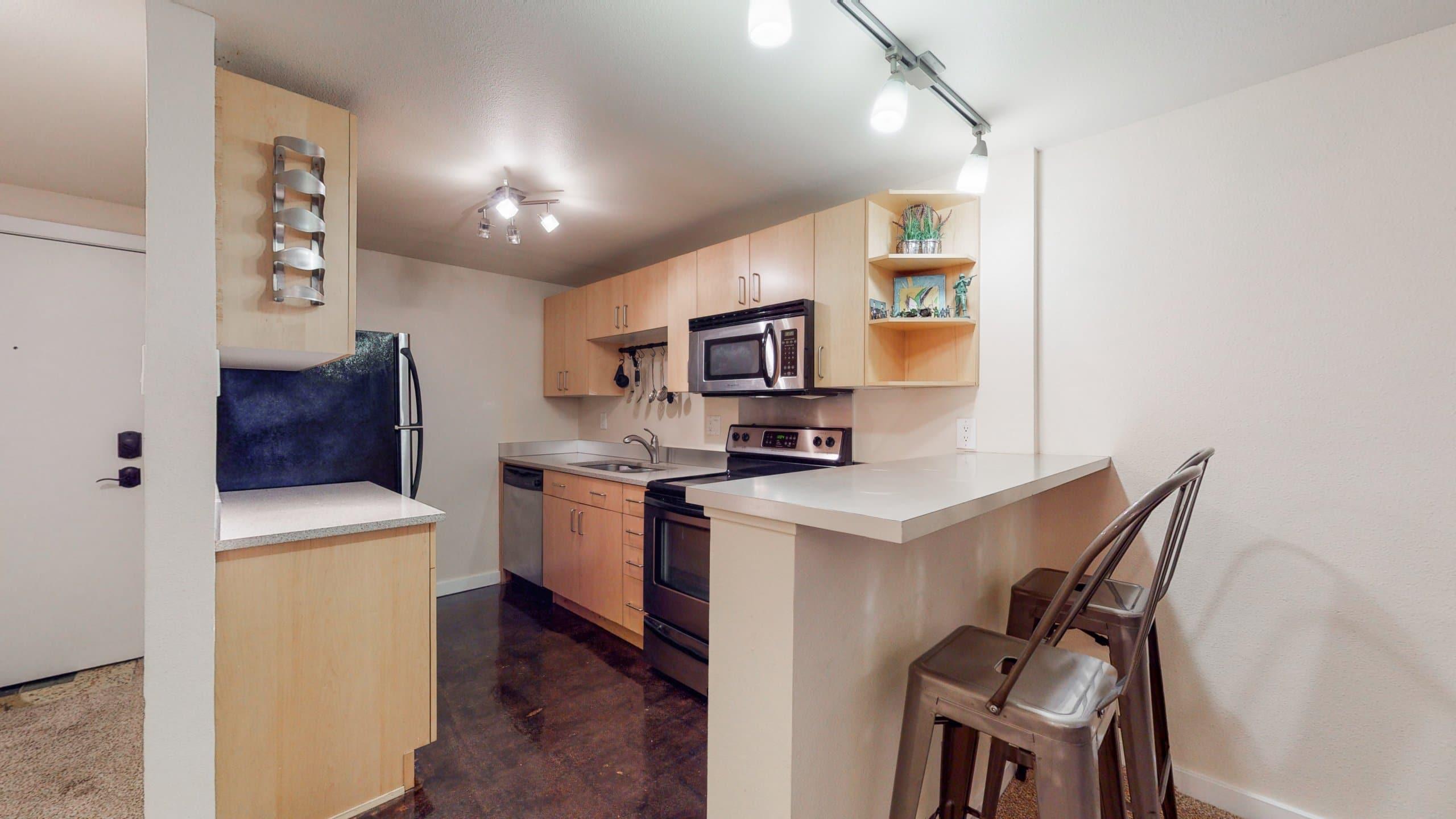 Congress Park Condo Kitchen with Corian Counters