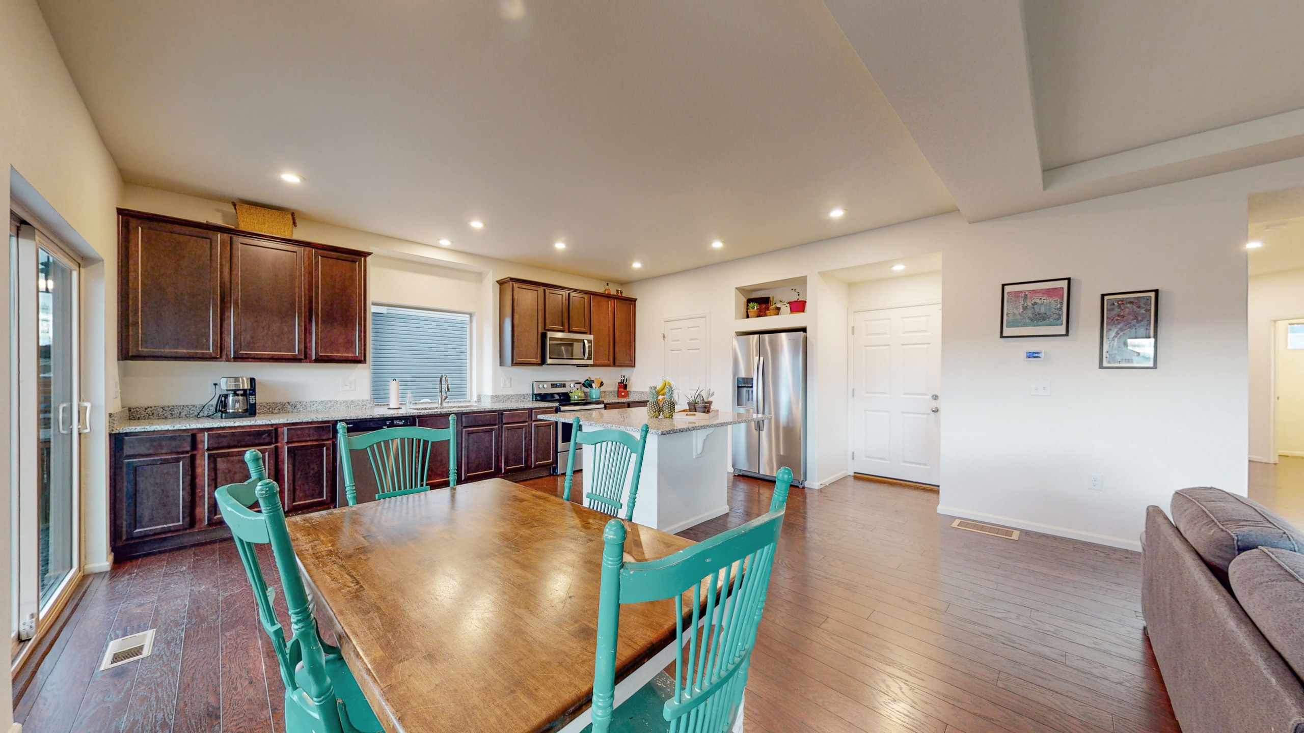 Kitchen with dark cabinets, white countertops, island