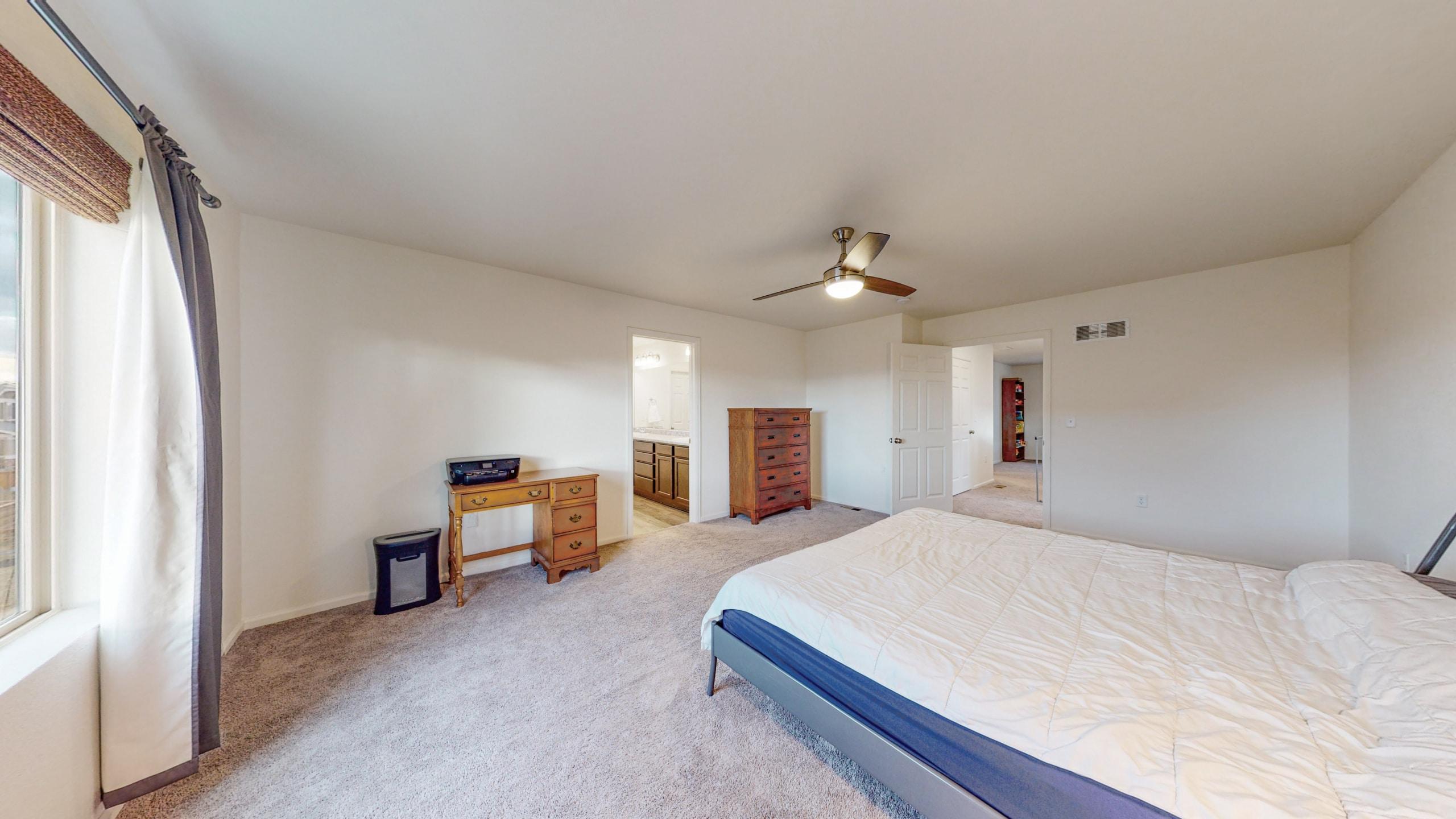 Master Bedroom with en suite bathroom and large walk-in closet