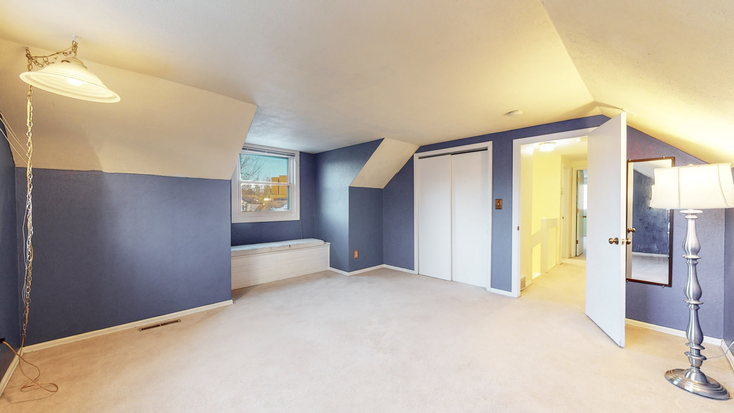 Brighton, CO home for sale, upstairs bedroom, blue walls, white trim, sitting bench