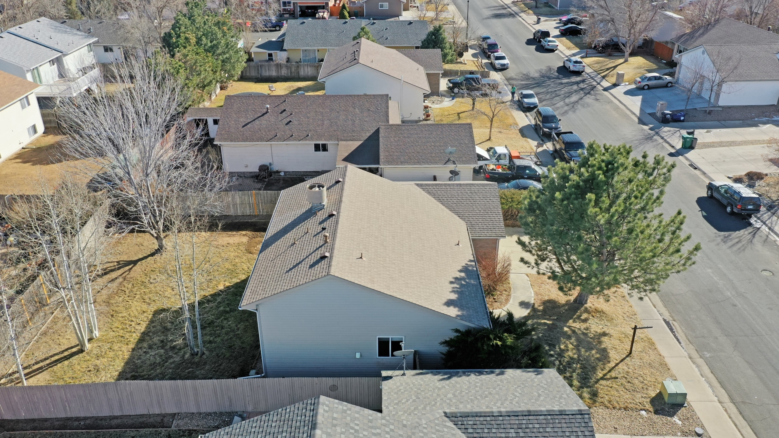 Brighton, CO house for sale aerial view of house and back yard with big trees