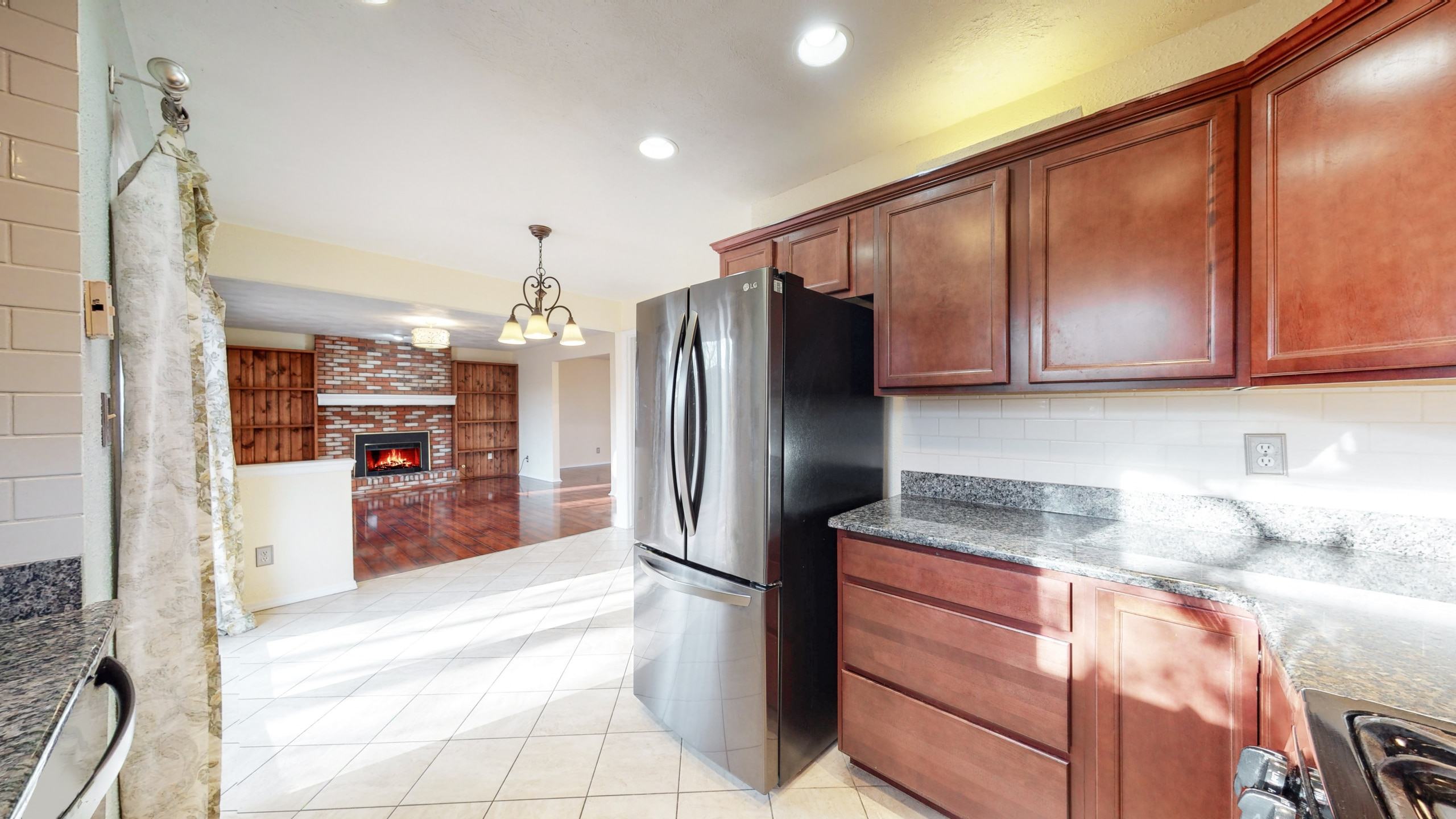 Brighton Home For Sale Kitchen, Stainless refrigerator, fireplace in background