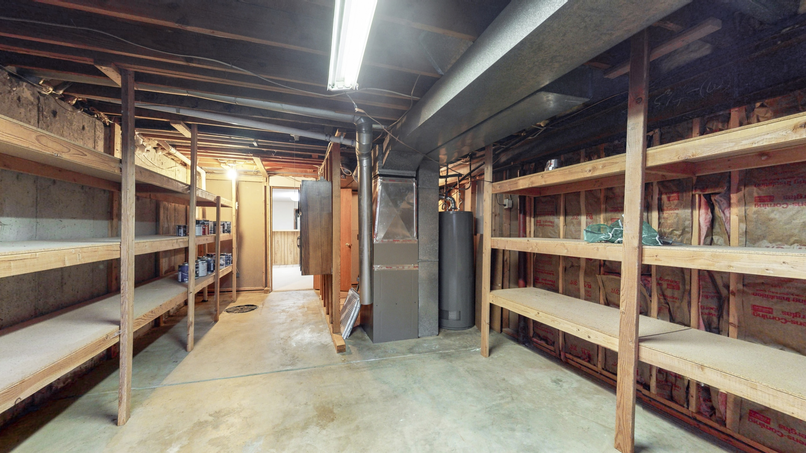 Brighton Home For Sale, built-in wood shelving in utility room