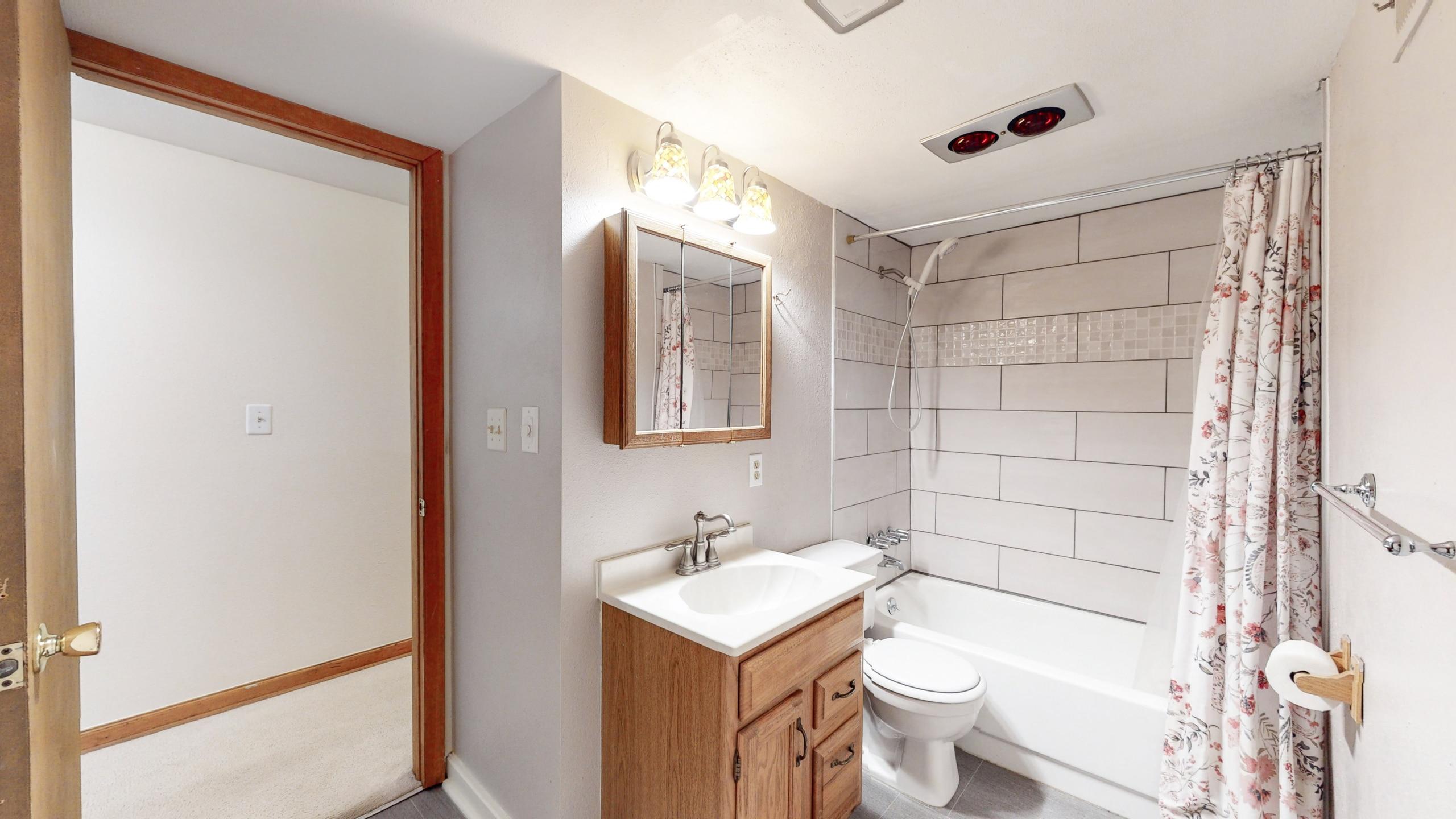 Brighton home for sale, basement bathroom, updated, nice white designer tile in shower