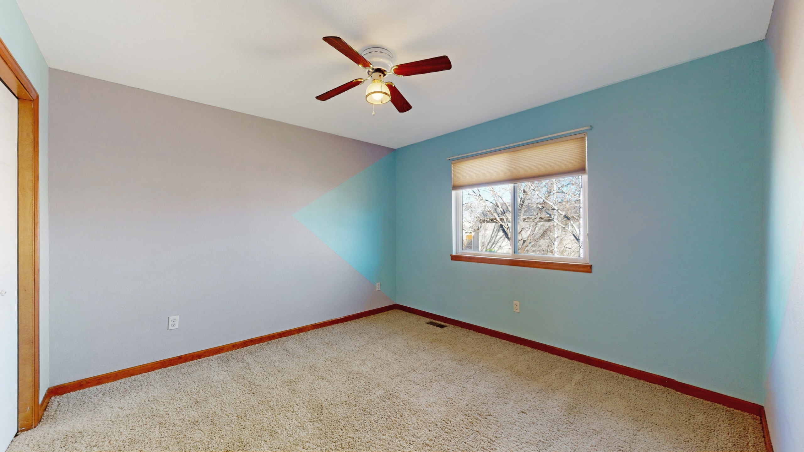 Brighton house for sale bedroom with blue grey walls and wood trim