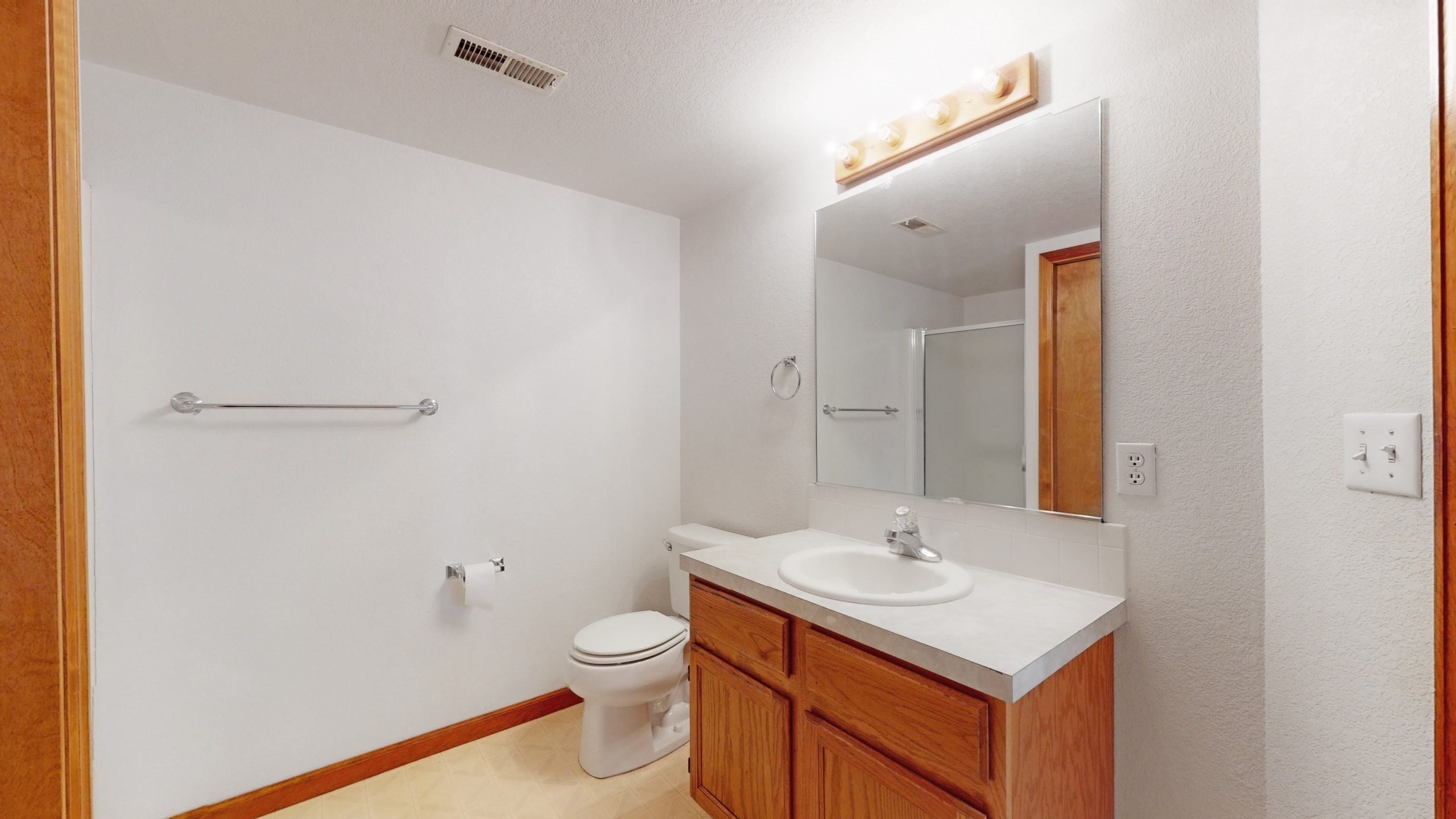 Brighton house for sale downstairs bathroom with white tile shower and laminate counters