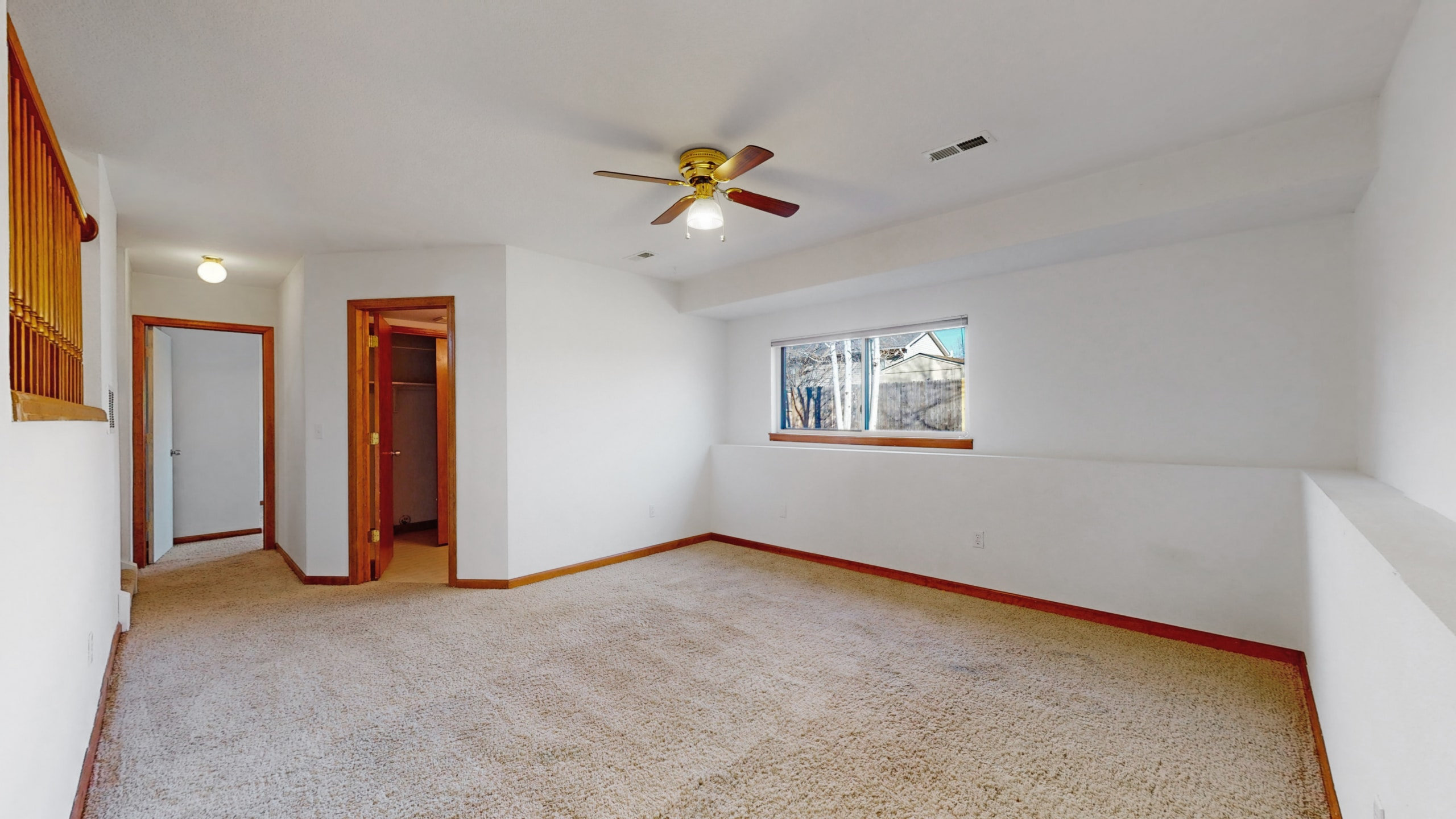 Brighton house for sale family room with white carpet white walls