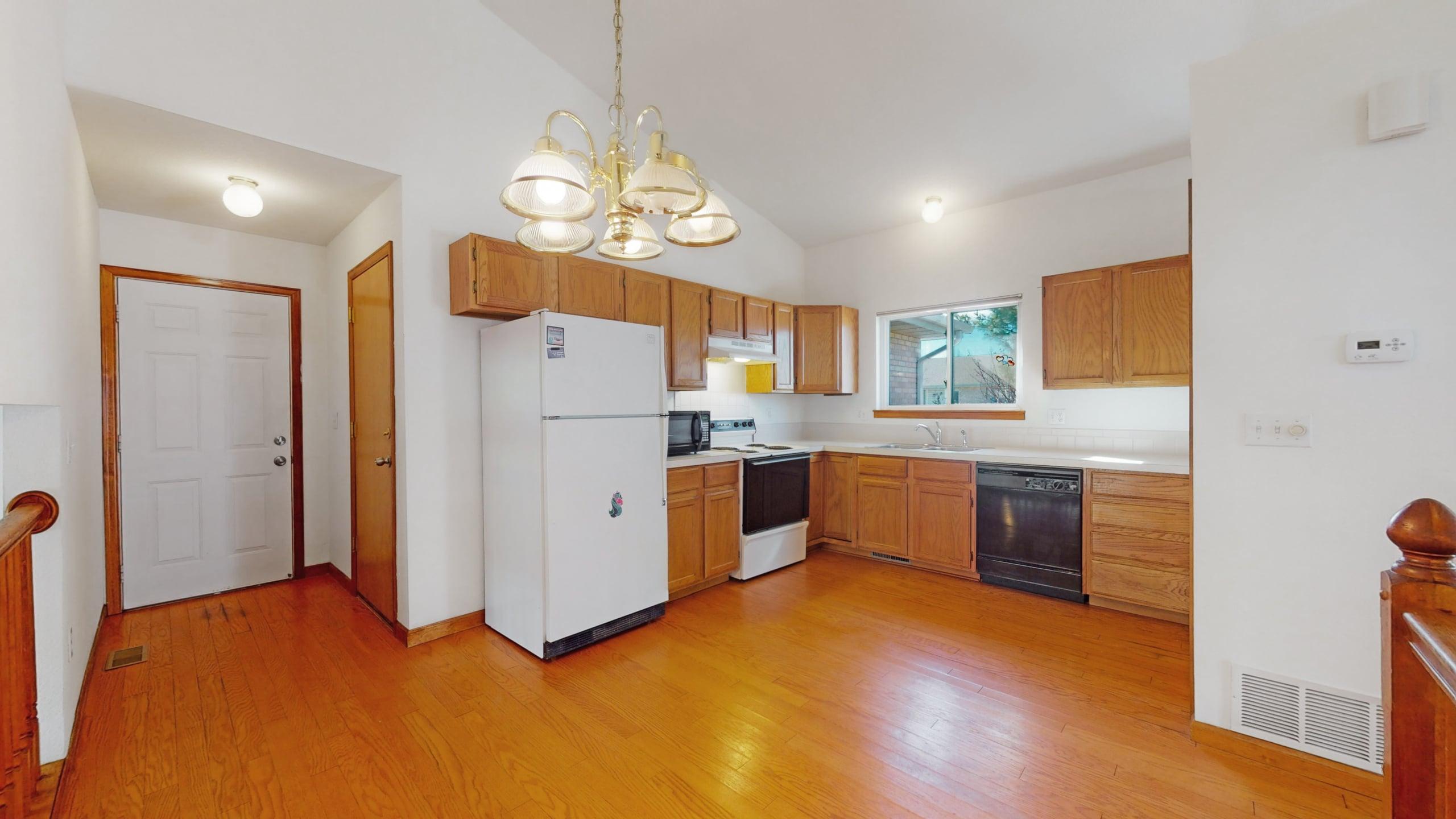 Eat in kitchen white walls, oak cabinets