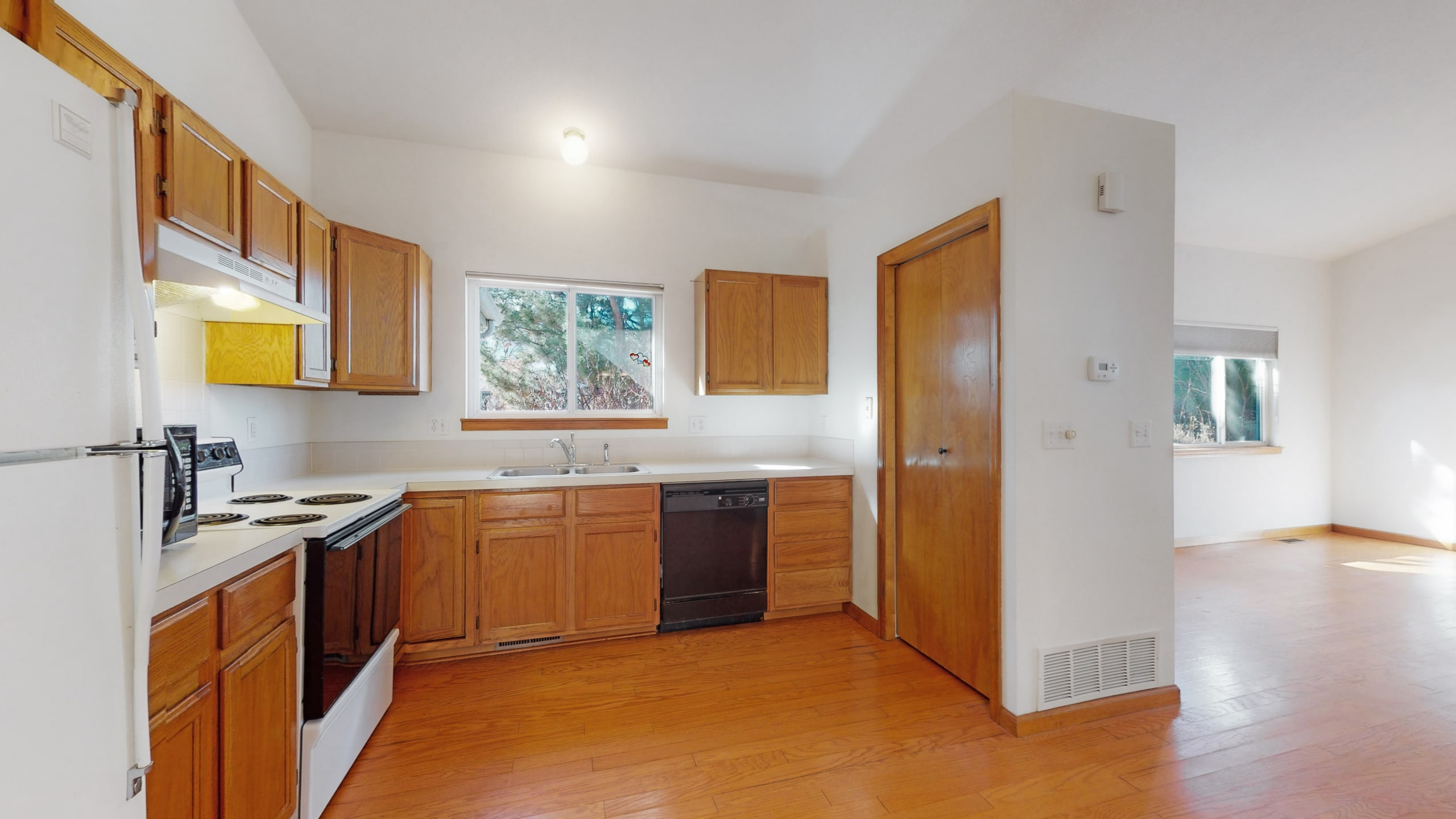 Kitchen with pantry, dishwasher, window over sink