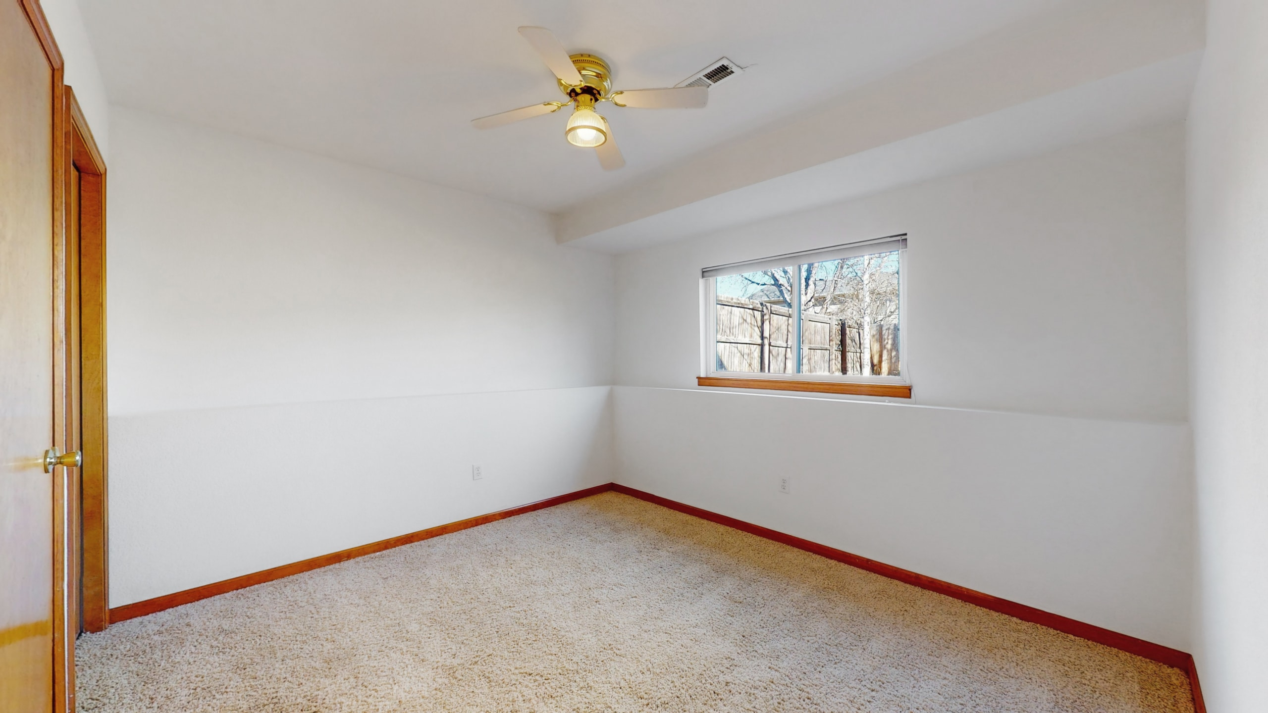 Lower Level Bedroom White Walls with wood trim, natural light