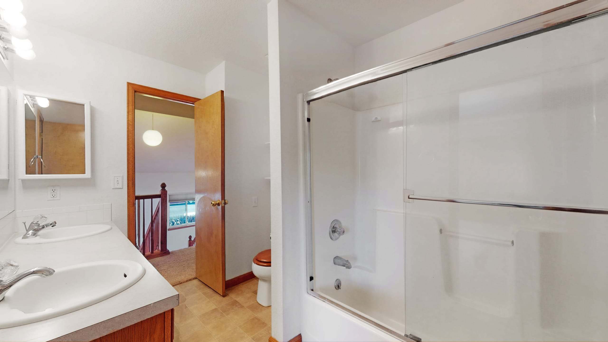 Master bathroom with white shower, glass door white walls and double sinks