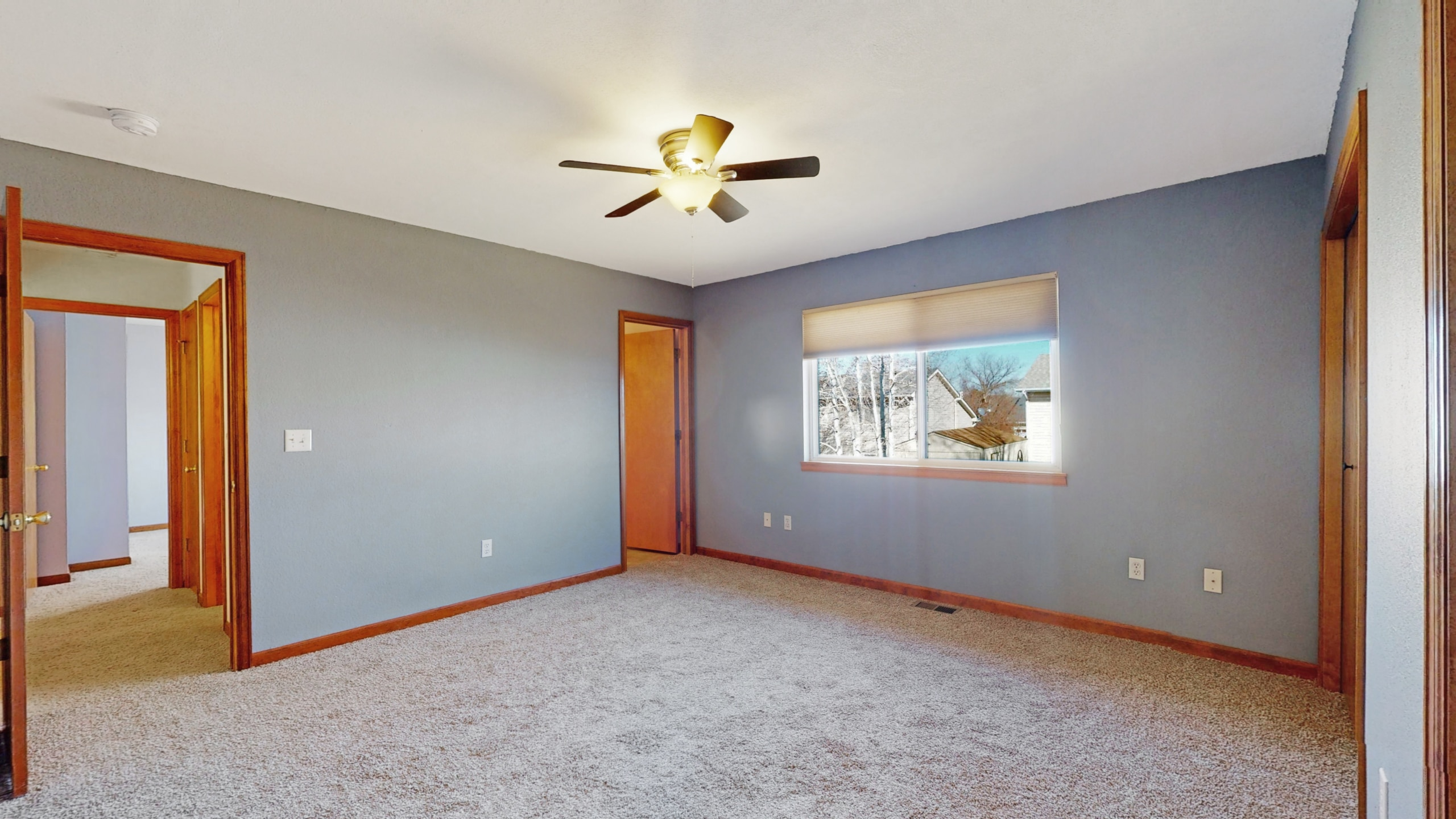 Master bedroom blue walls with gorgeous wood trim