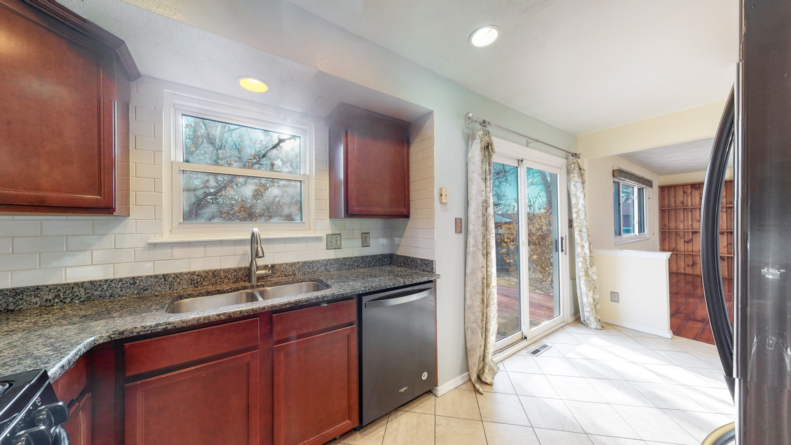Open Concept Kitchen, Connect to patio, stainless steel dishwasher, window over sink