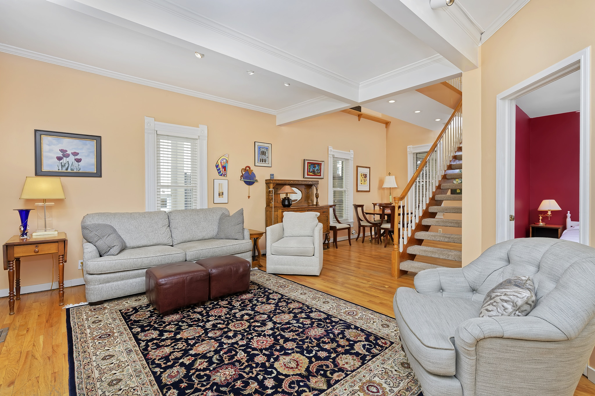 Main Living room with 9 foot coffered ceilings, crown molding, oak floors, charming architecture