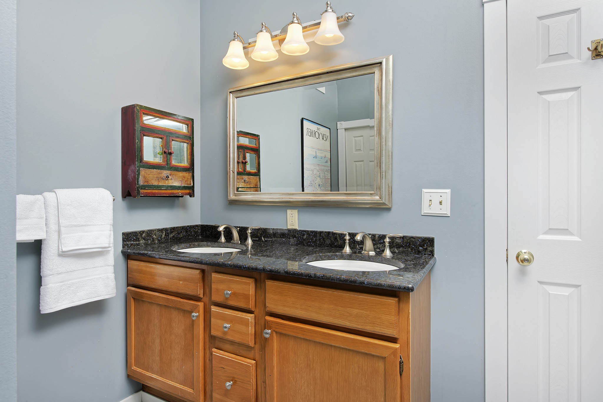 Washington Park Home for sale with double vanity and granite counters