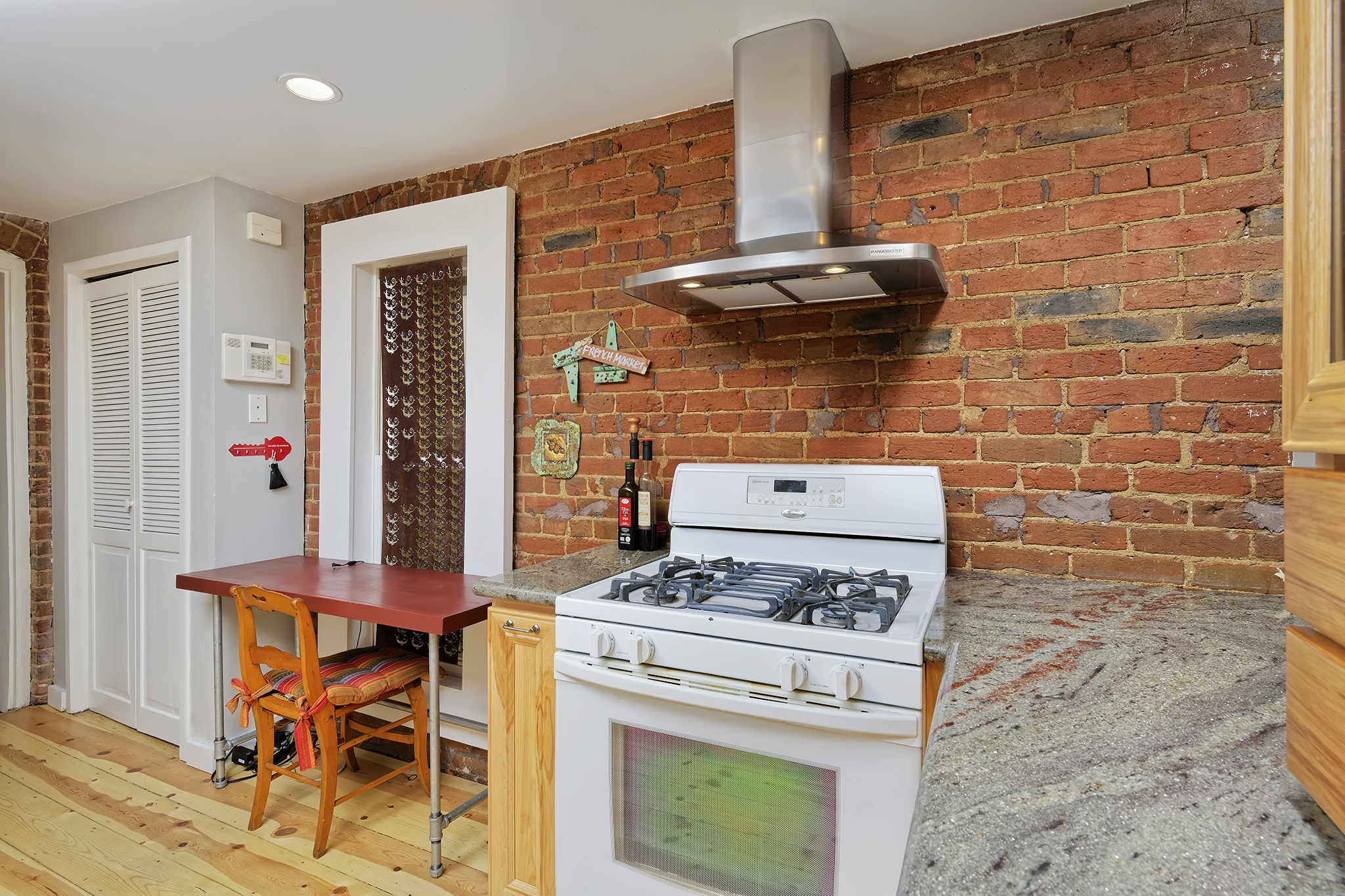 Washington Park Kitchen With Exposed Red Brick, Stainless Vent Hood