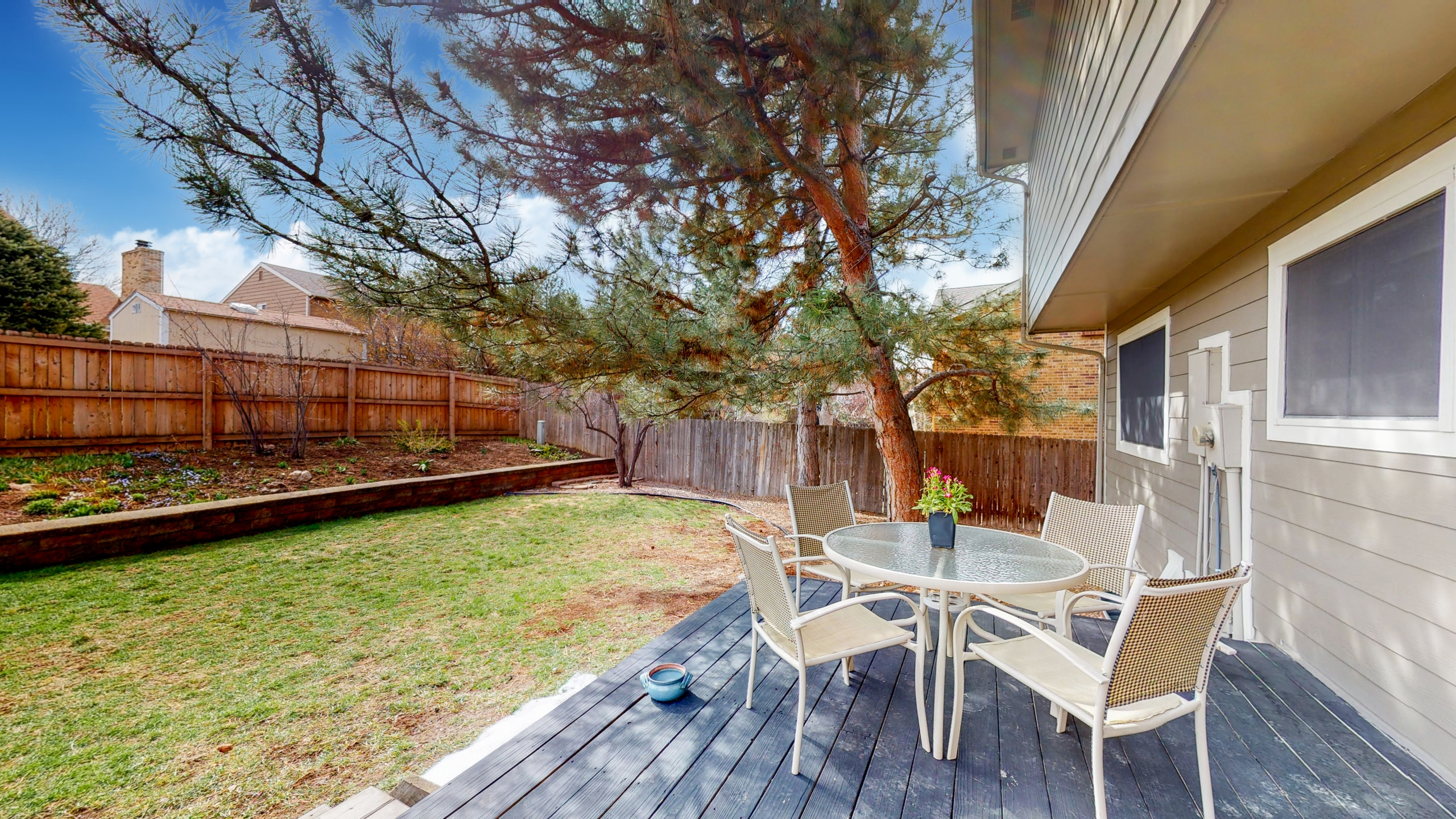 Backyard with large deck and big trees
