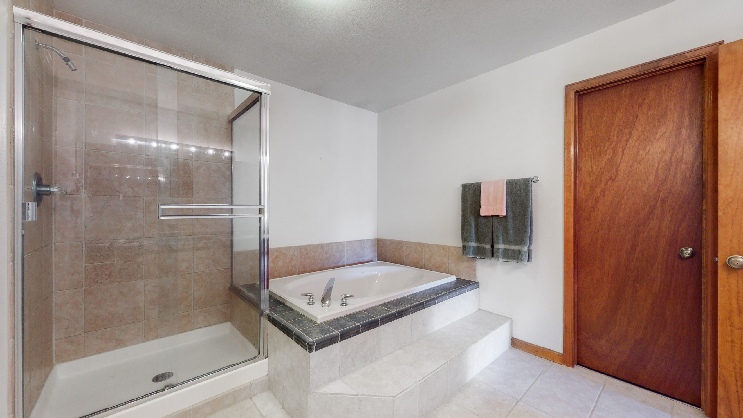 Five piece bathroom with shower and tub