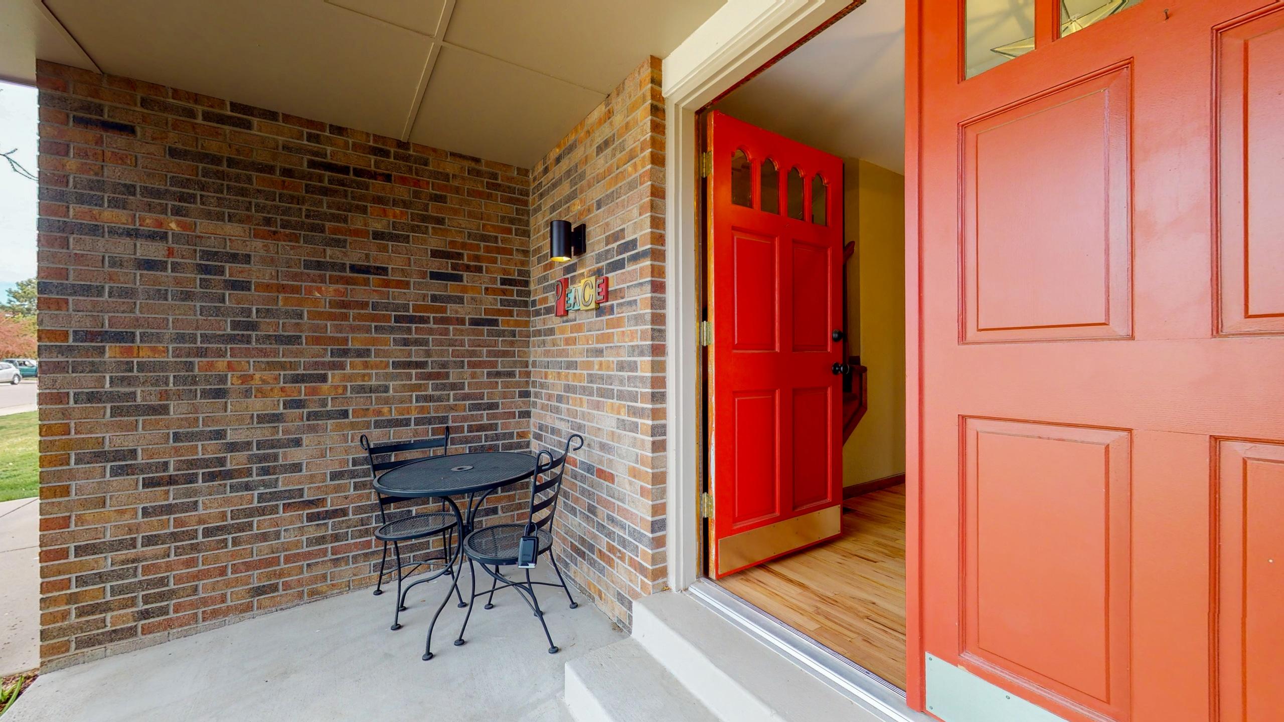Front door, red double doors with brick exterior