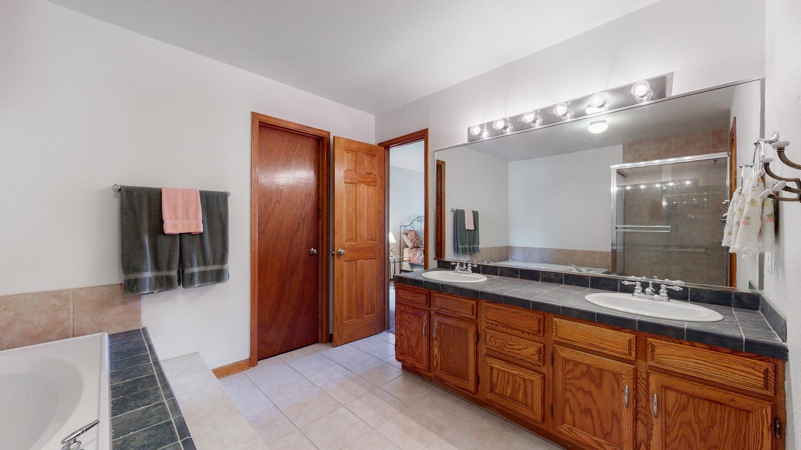Master bathroom features full length mirror and walk in closet