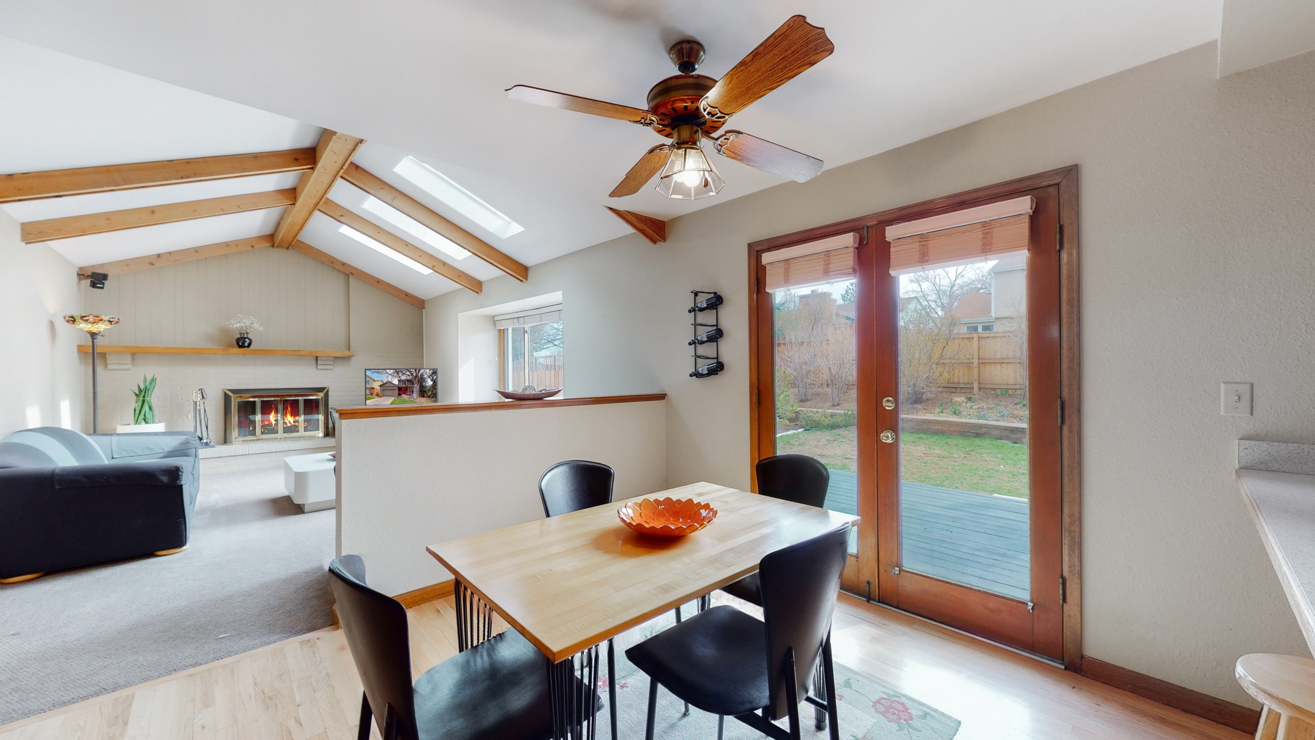 Open concept kitchen and living room opens to deck