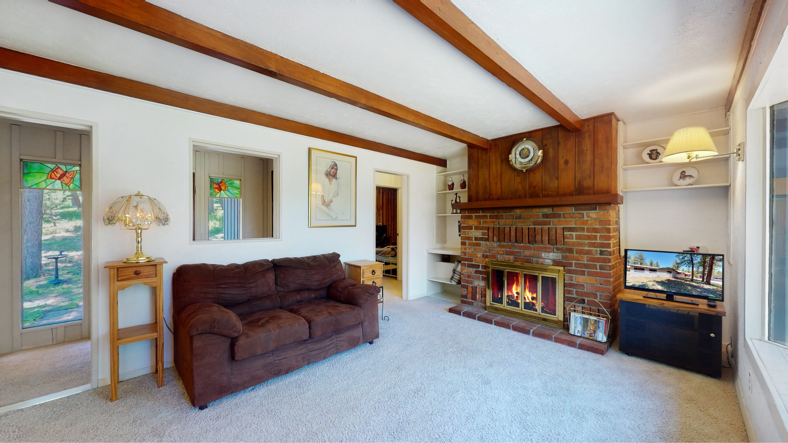 Brick fireplace with brick surround in Evergreen, CO