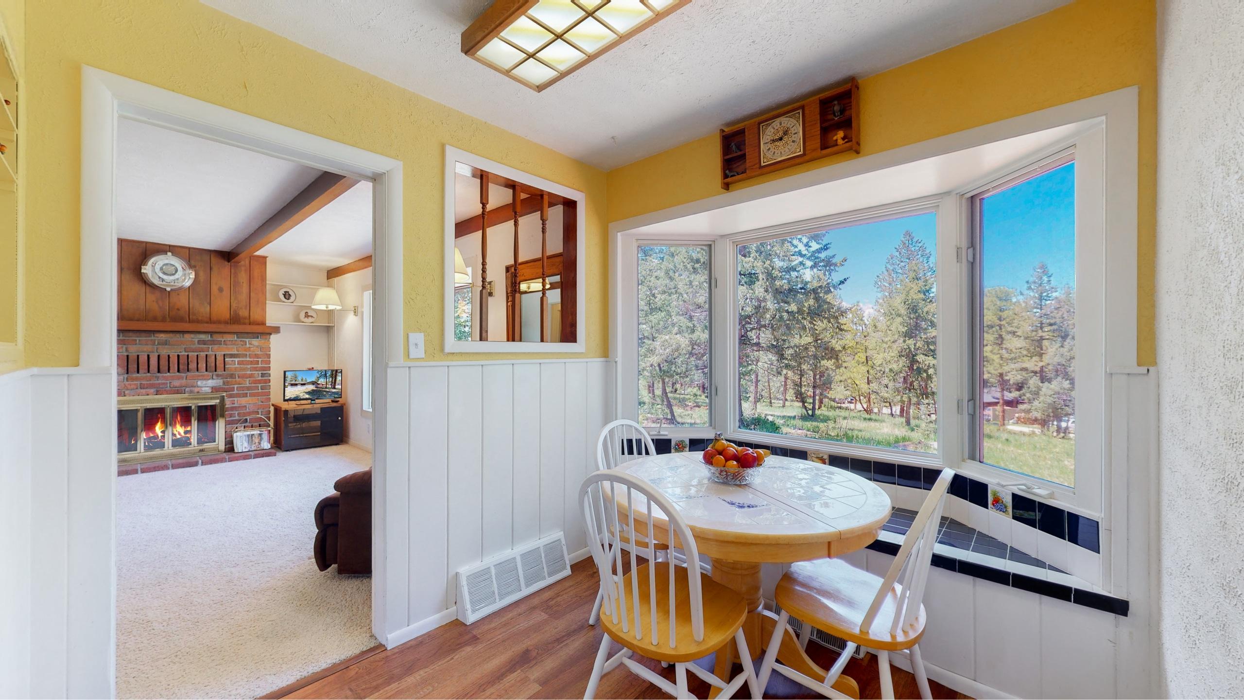 Dining room with big bay windows to watch wildlife