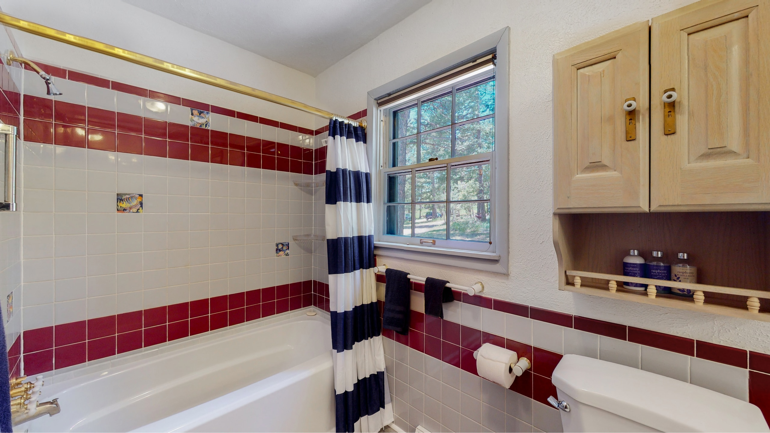 Evergreen, CO home for sale red and white tile in master bathroom