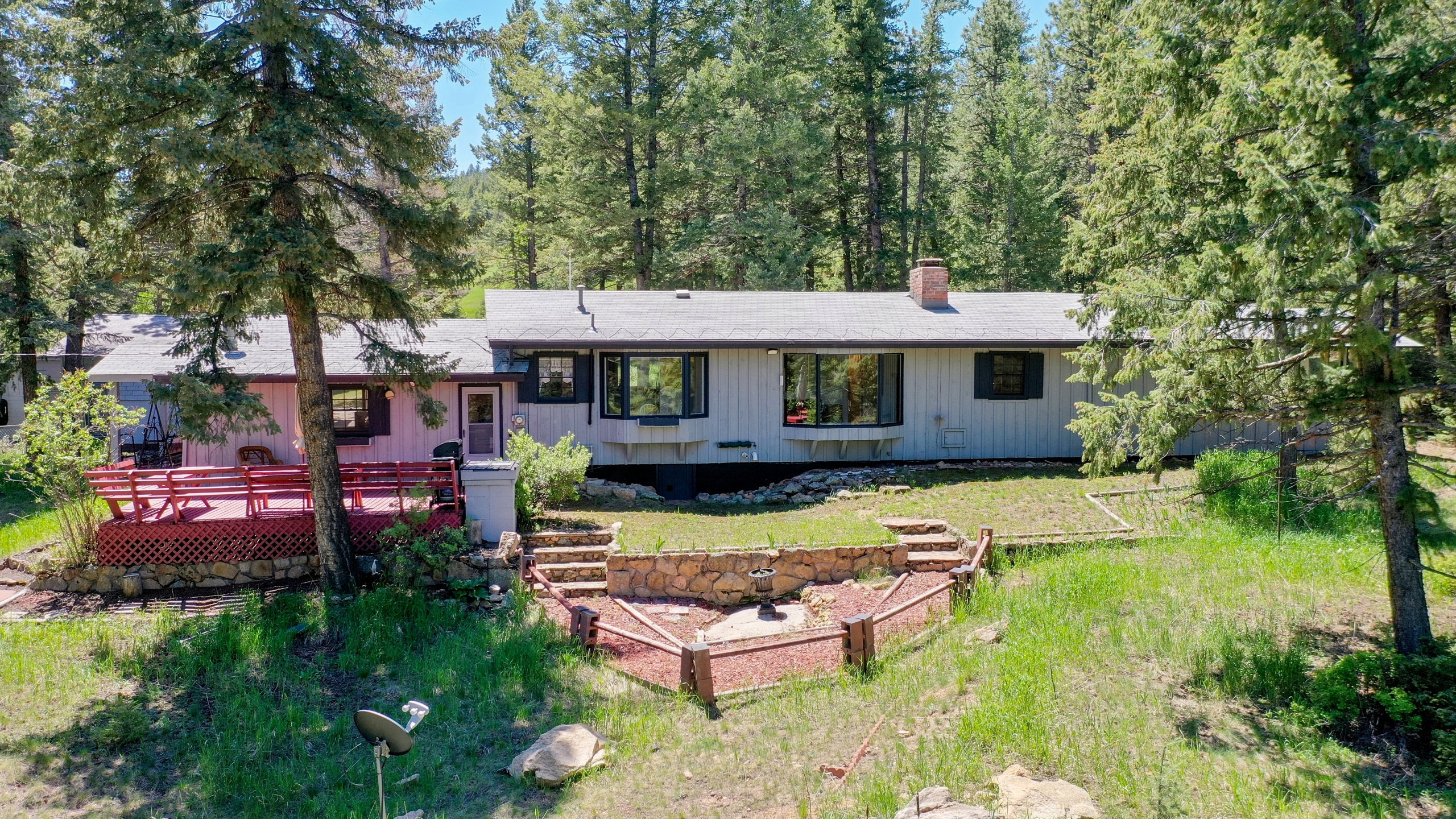 Evergreen home for sale ranch back of house large windows