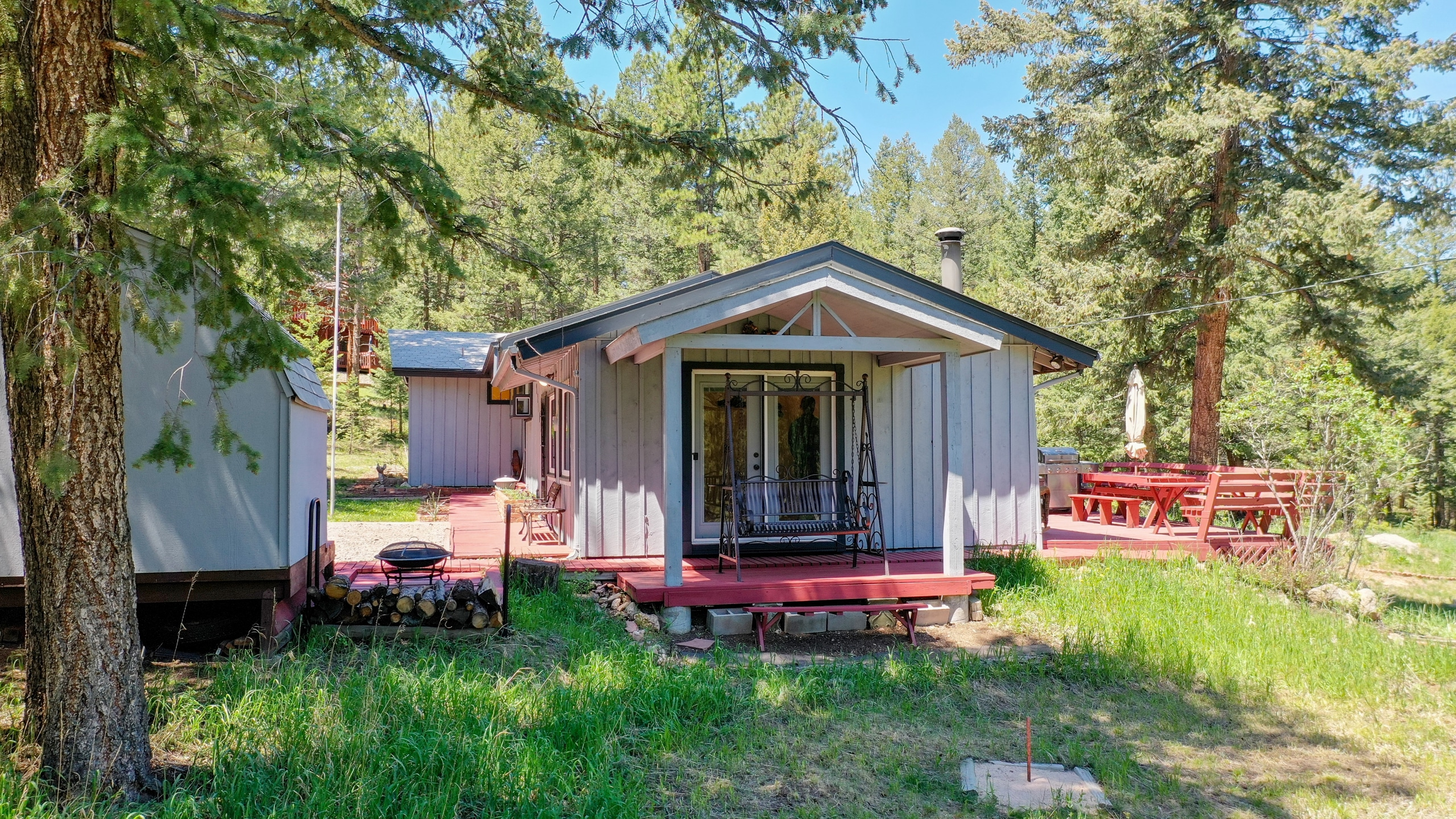 Evergreen home for sale with covered porch swing