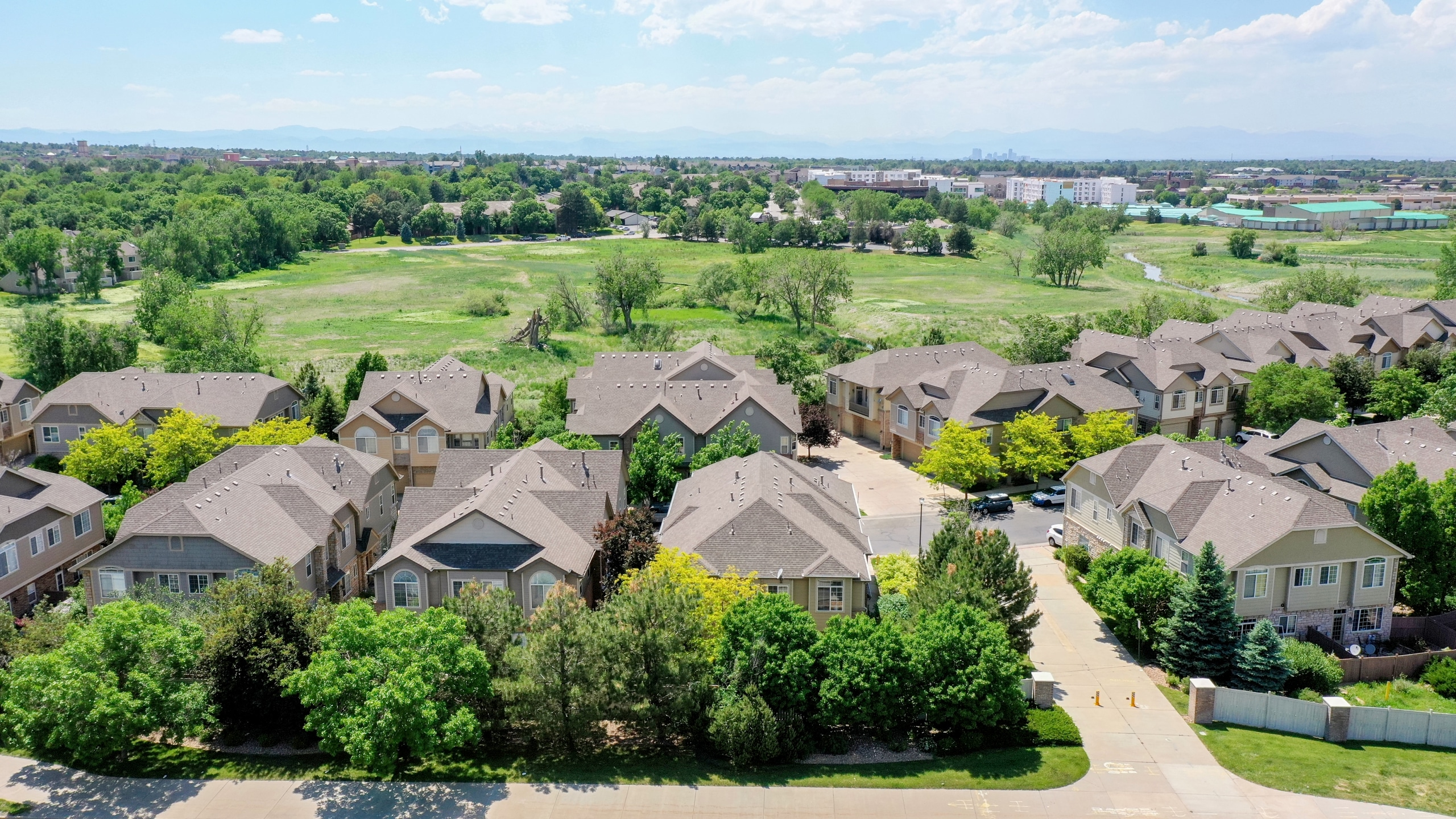 Large green park behind the townhome for sale