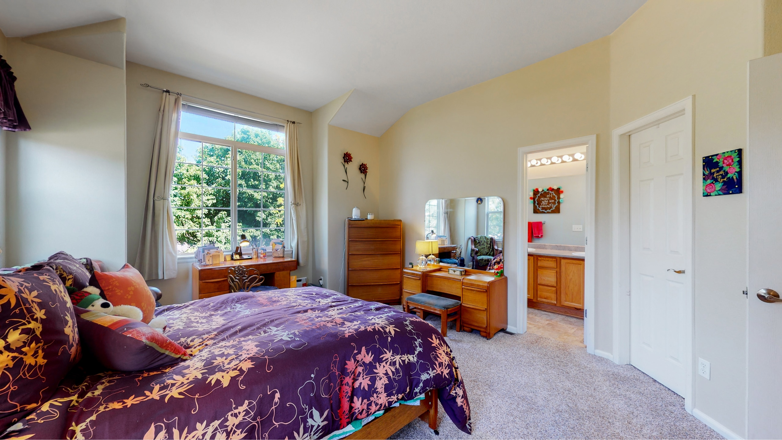 Master Bedroom With Large Windows and Private Bath Walk-in Closet