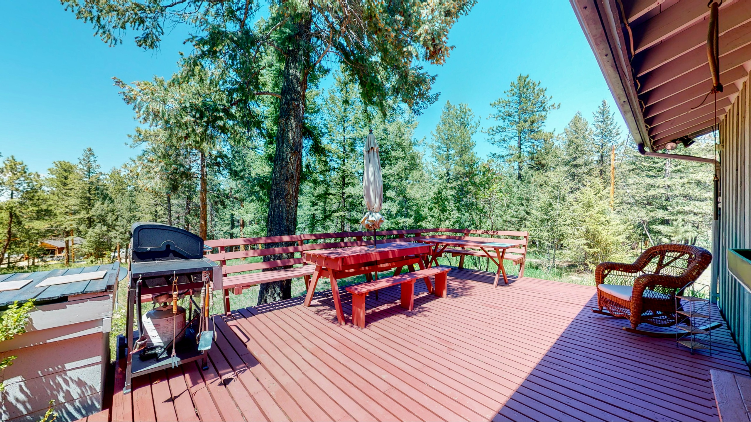 Red back deck with bbq overlooking 2 acres