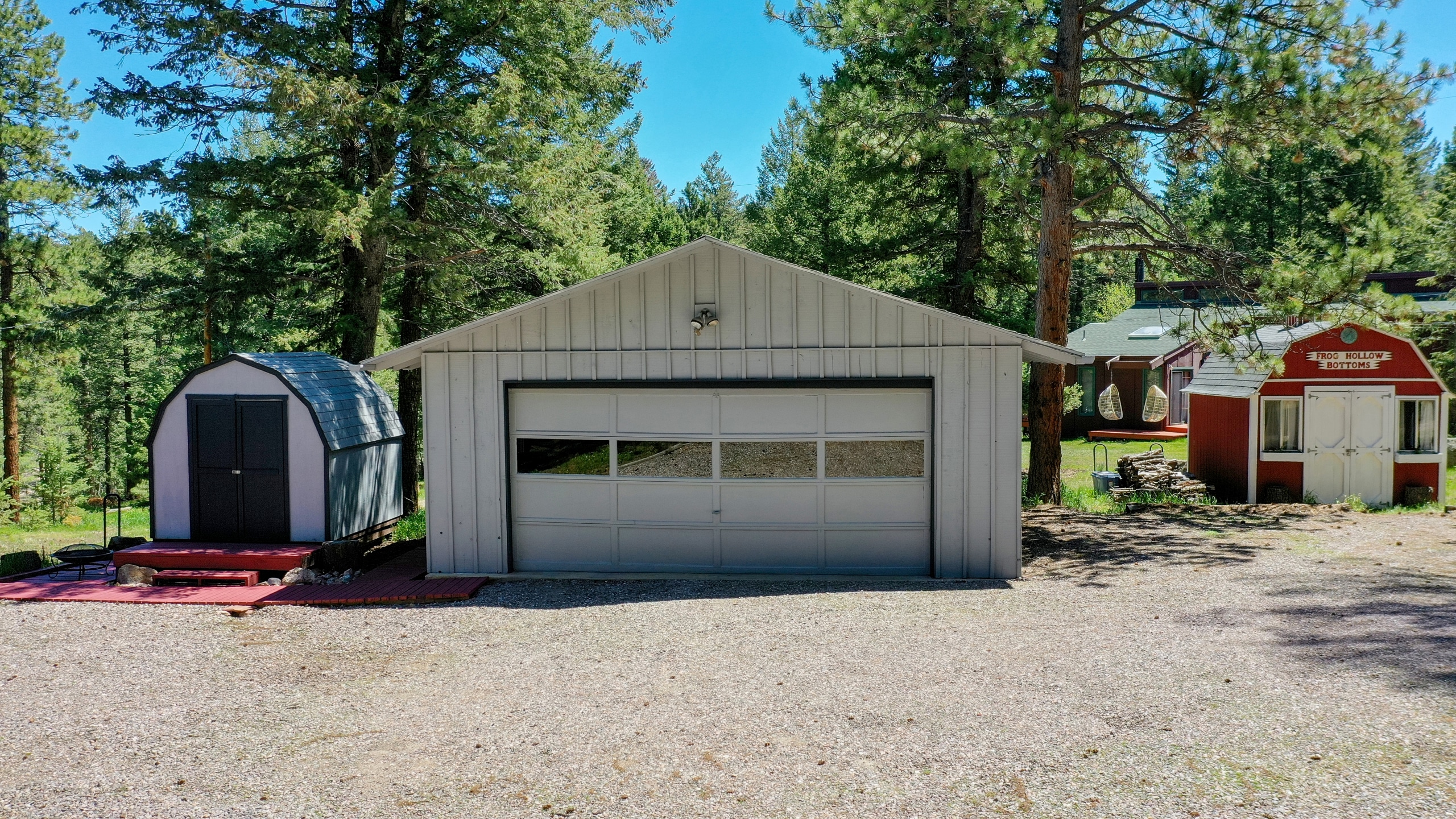 Two storage sheds and large heated two car garage