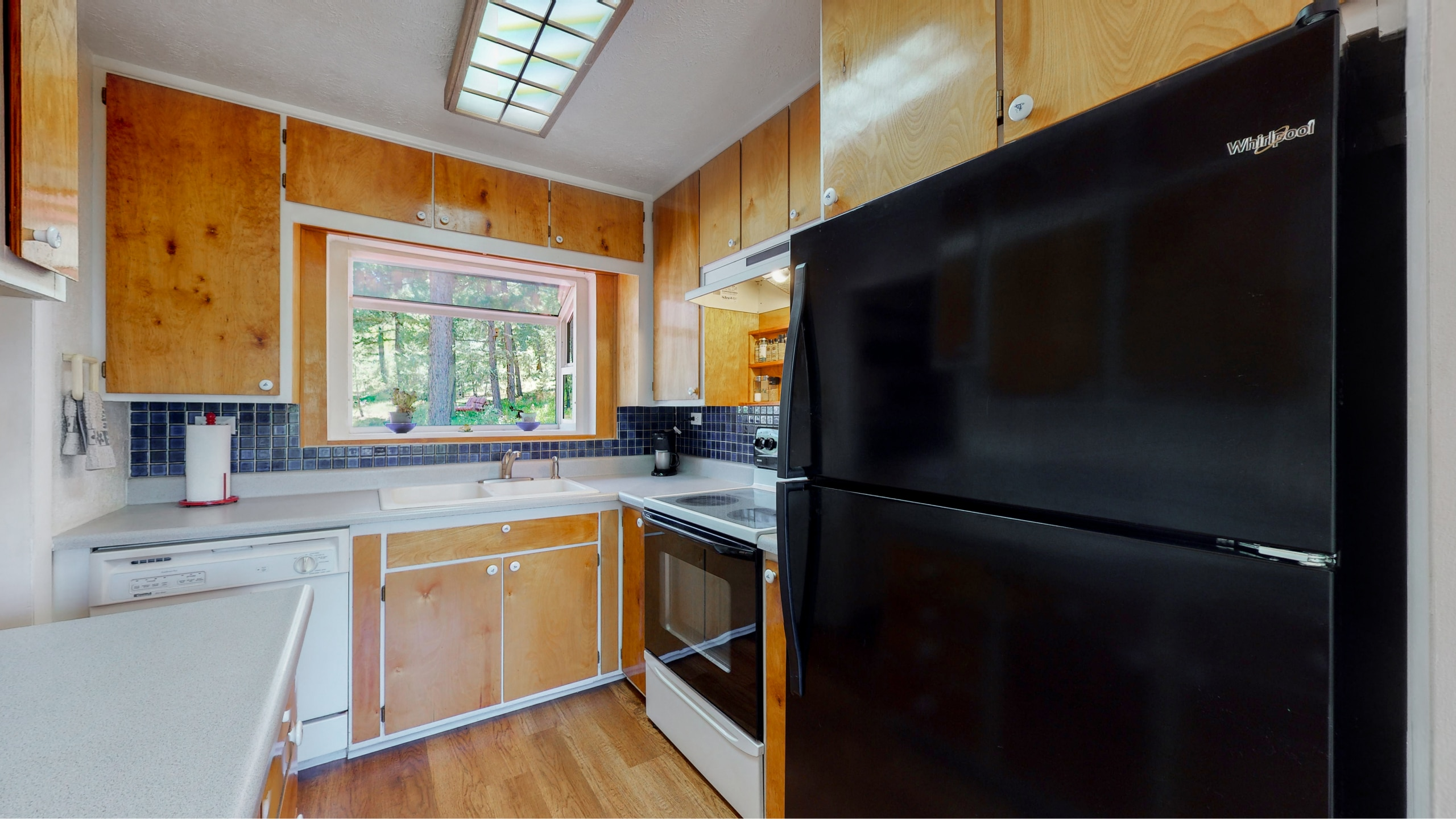 Wood cabinets with large bay window in kitchen home for sale