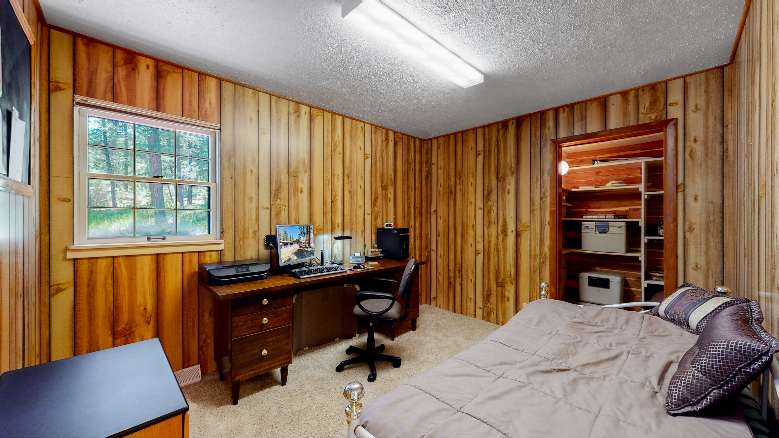 Wood paneled wall bedroom or office