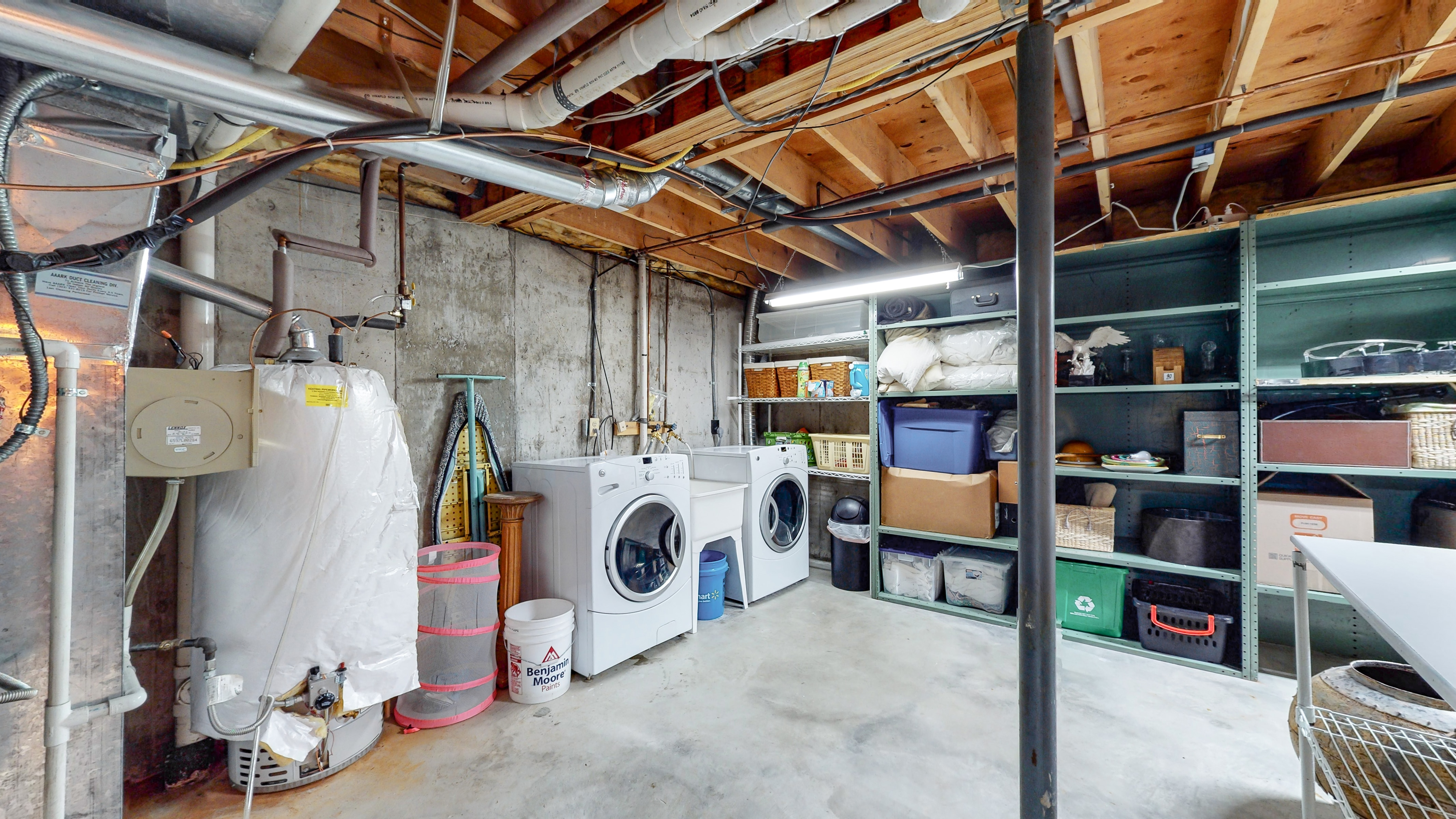 Basement storage area and laundry in Arvada, CO home for sale