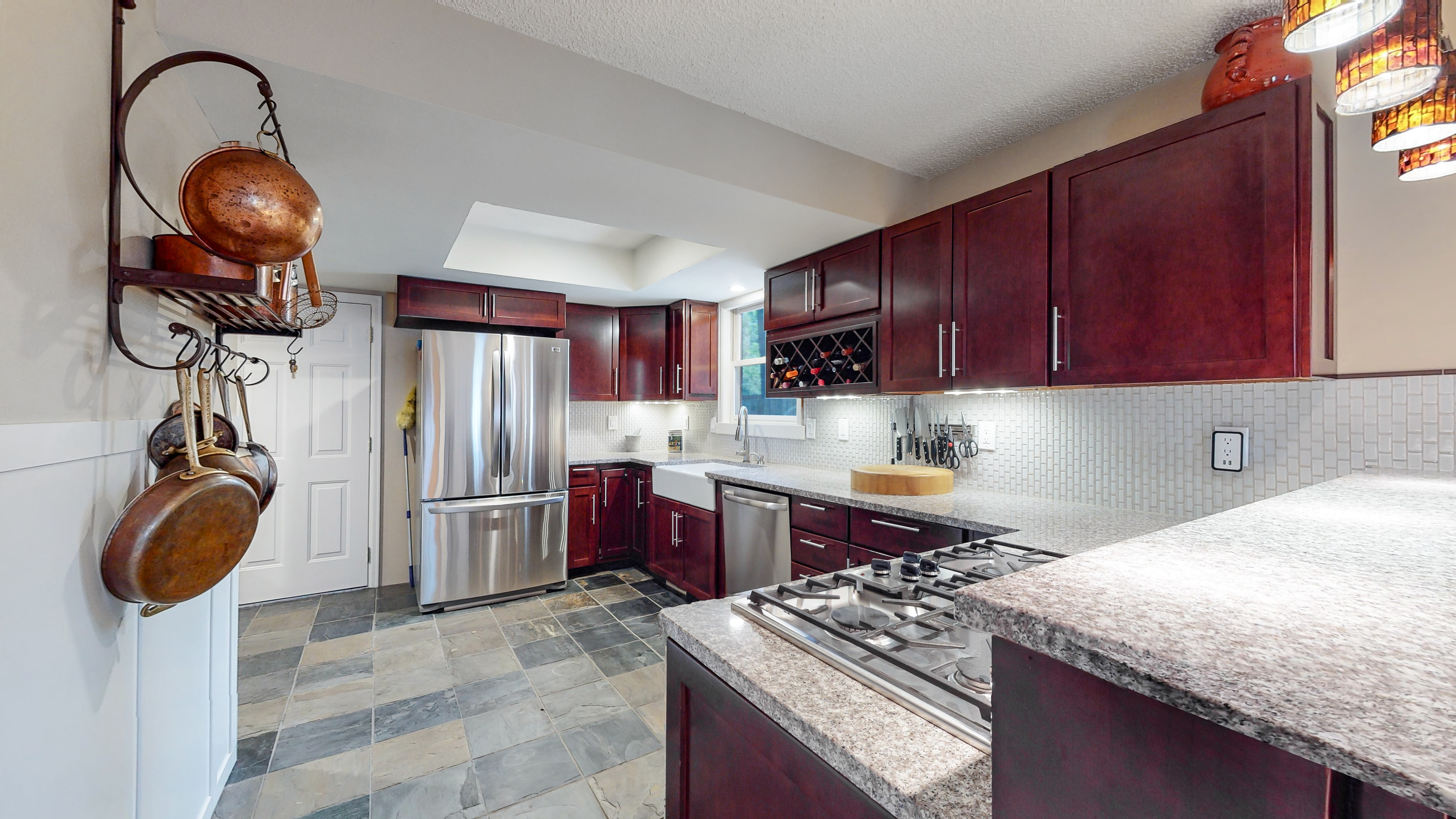 Custom kitchen, granite counters, stainless appliances, slate floor