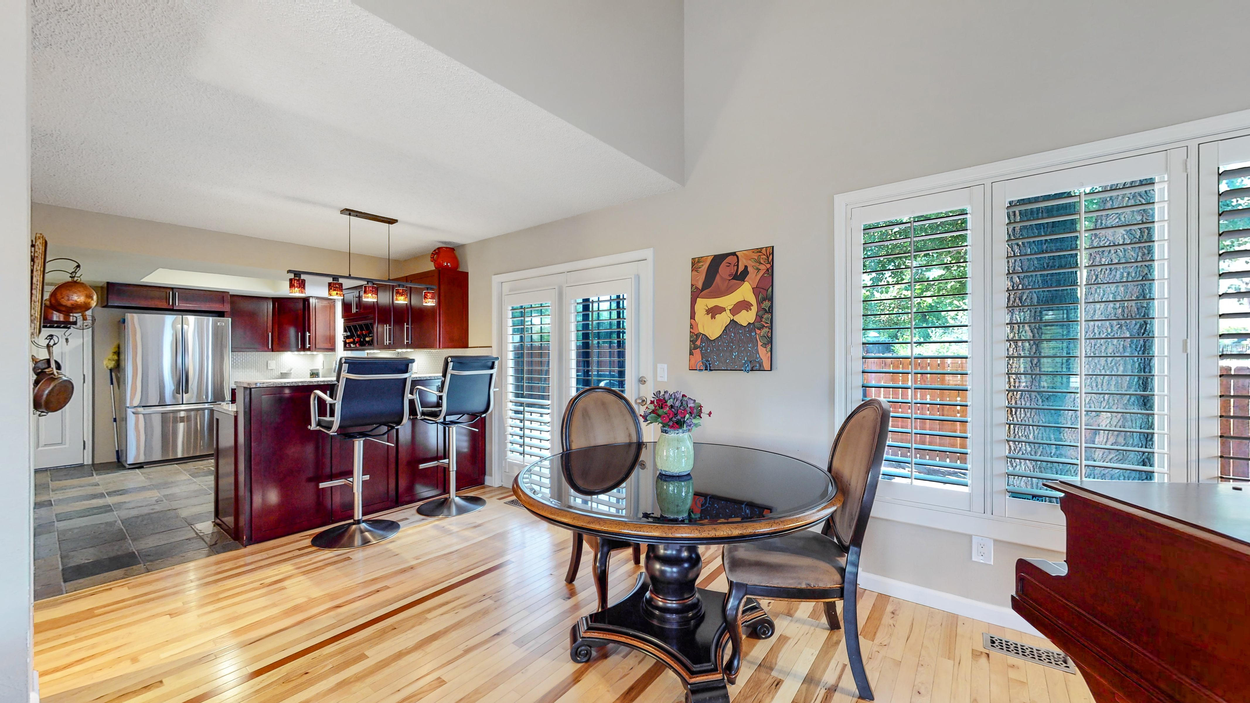 Dining room opens up to kitchen, Arvada home for sale