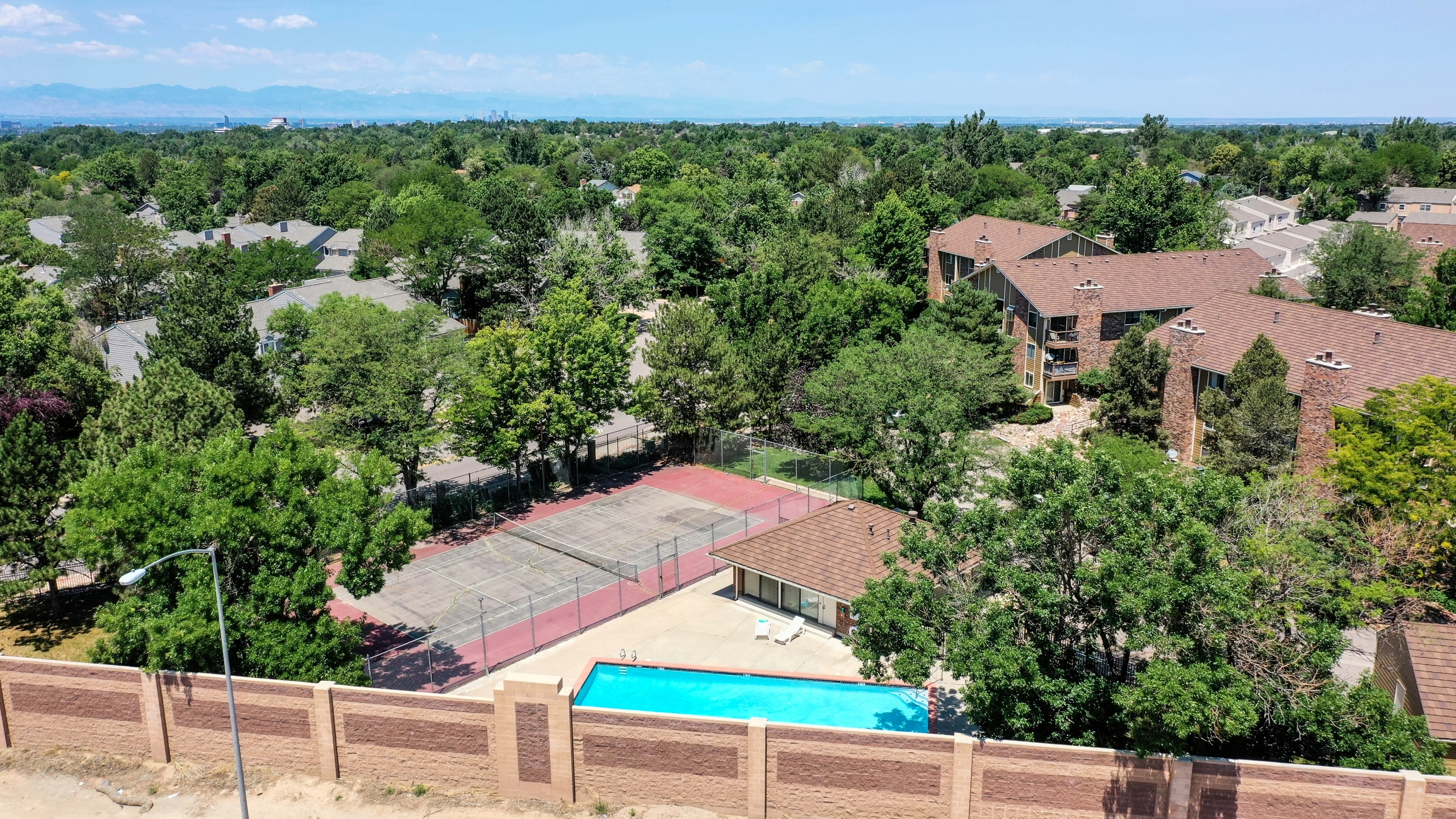 Drone View of Spinnaker Run II Condo Pool and Tennis Courts in Aurora, CO