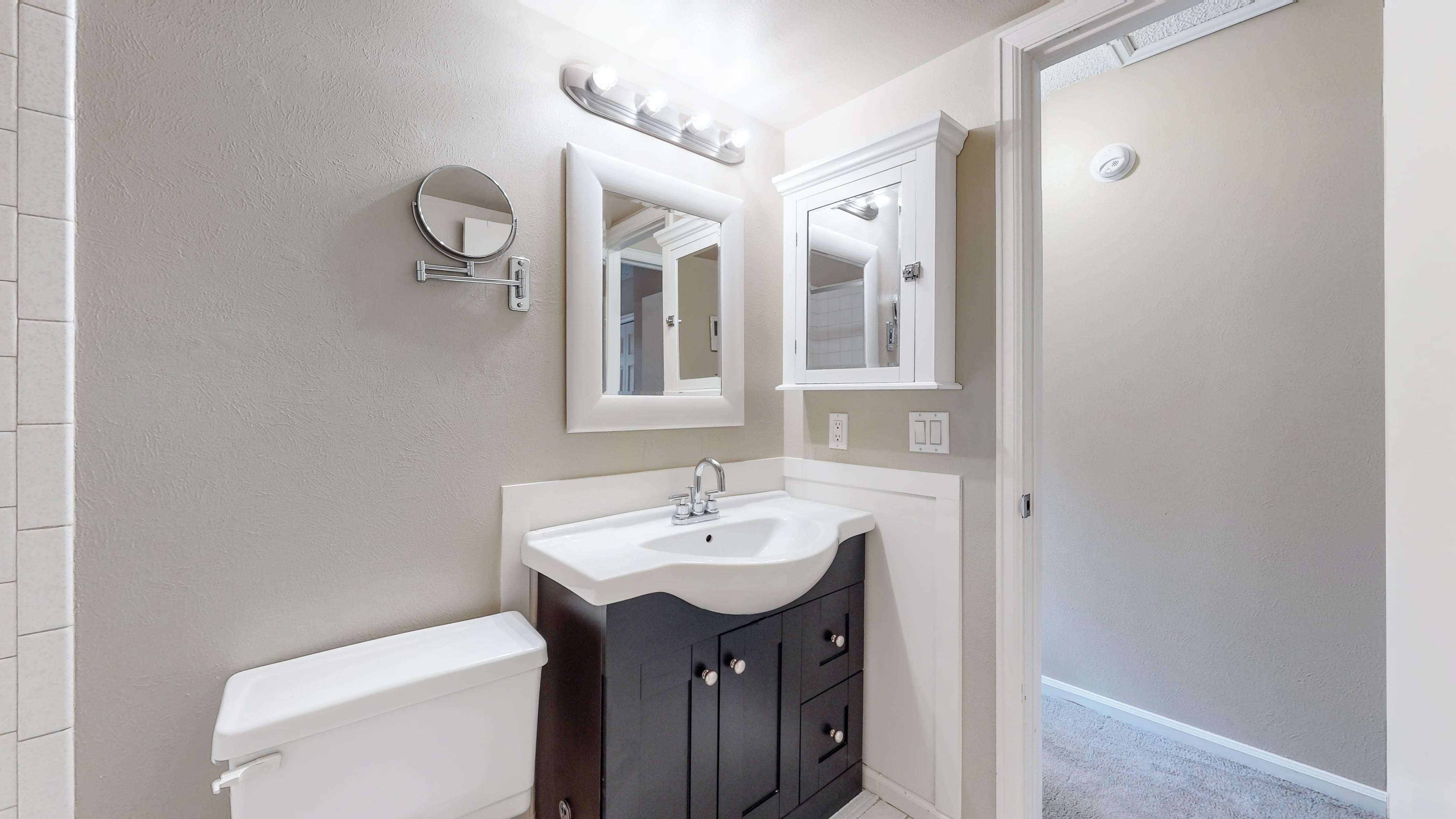 Home for sale in Arvada, bathroom with white sink, black vanity
