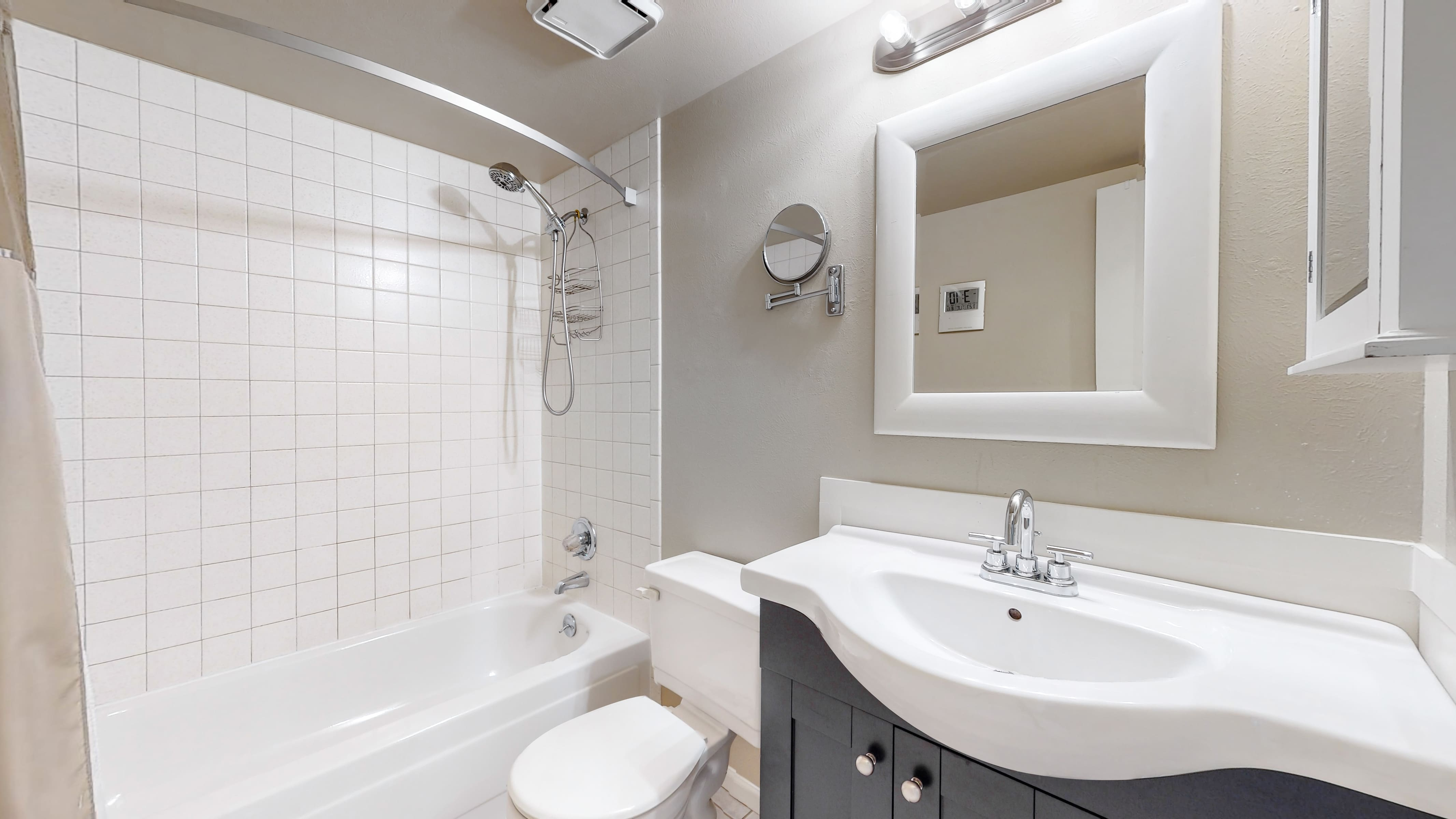 Home for sale in Arvada, upstairs bathroom, white tile