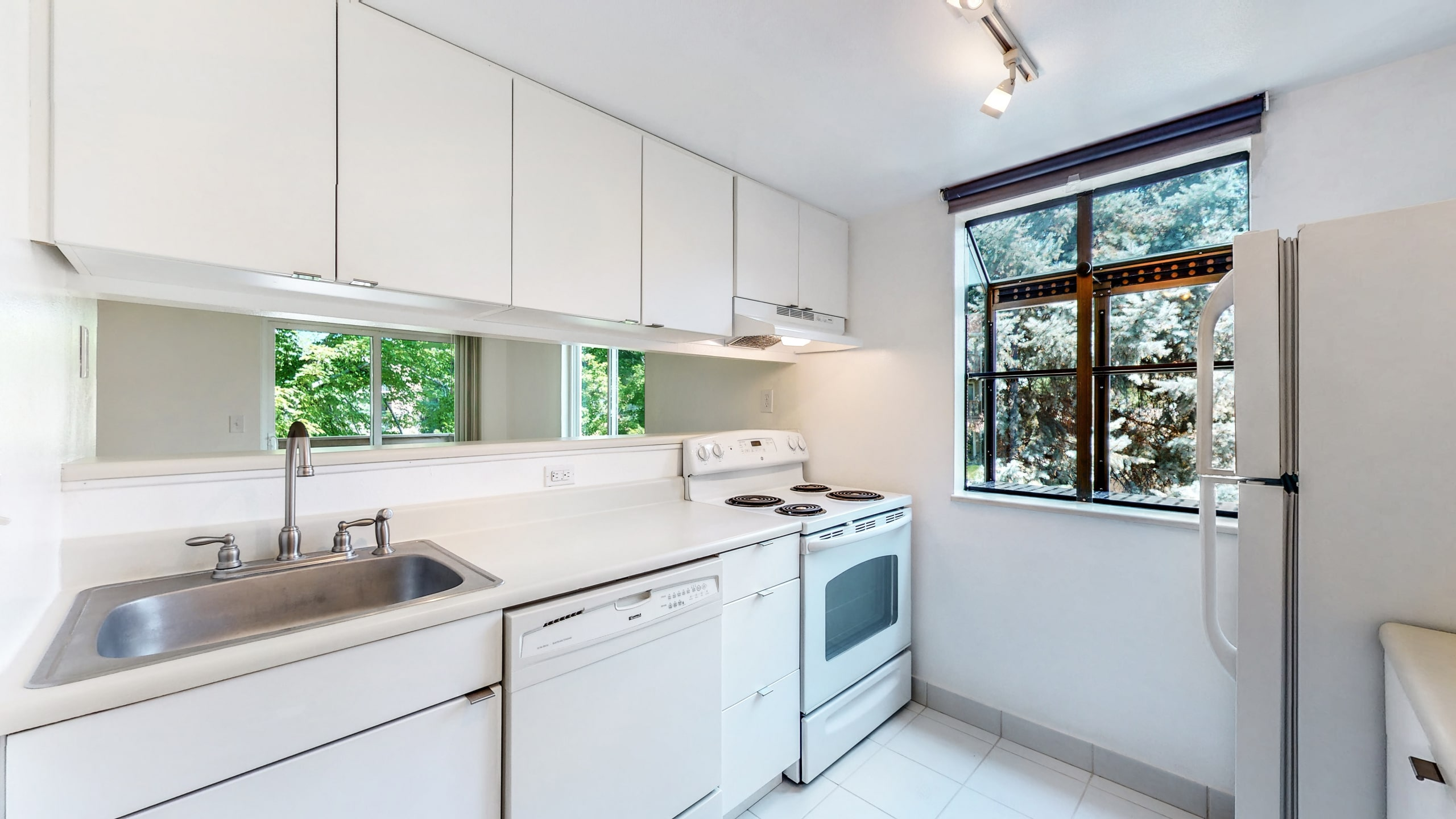 Kitchen with new white cabinets and white counters at Spinnaker Run II