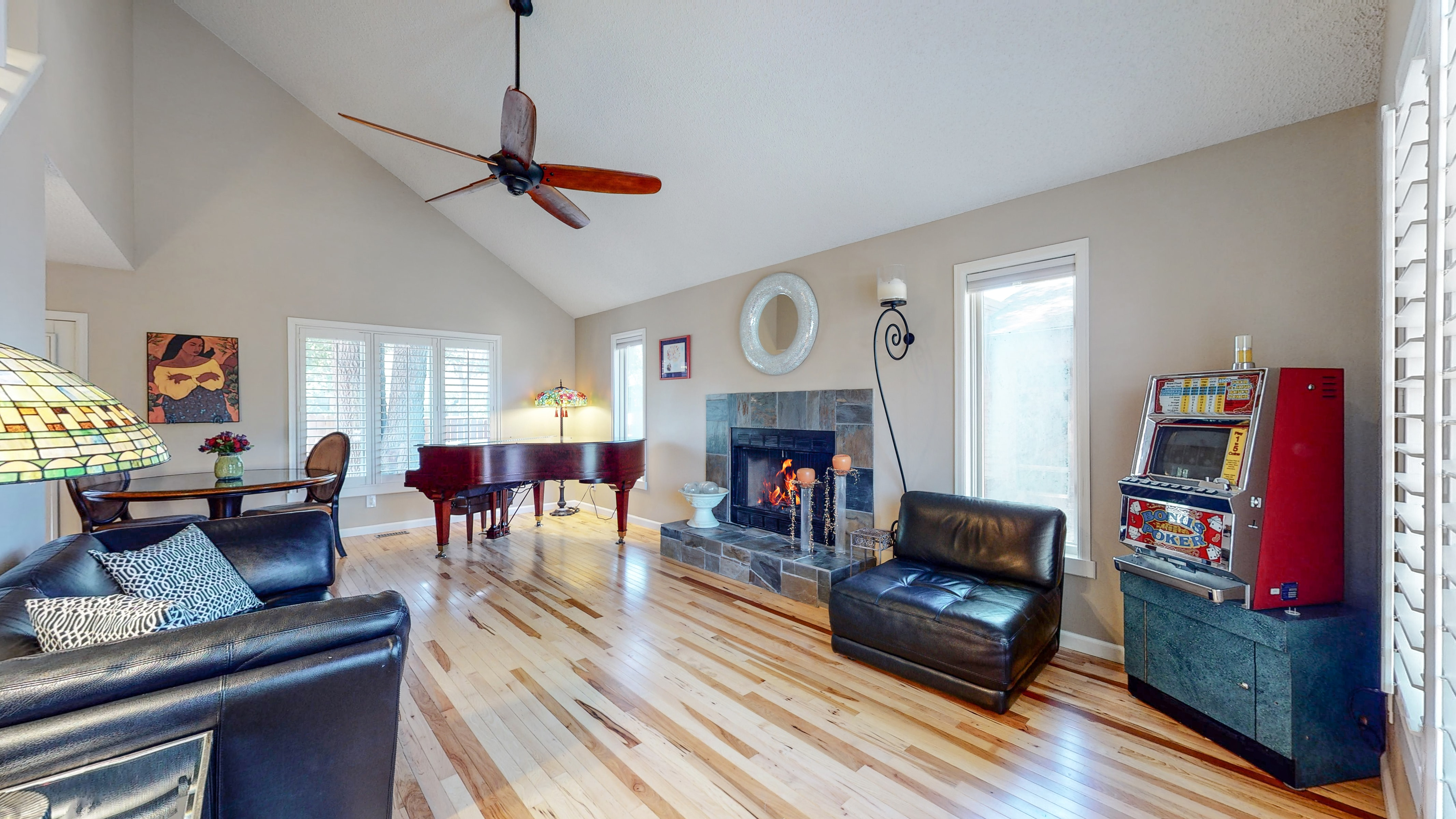 Living Room with real hardwood floors and white shutters